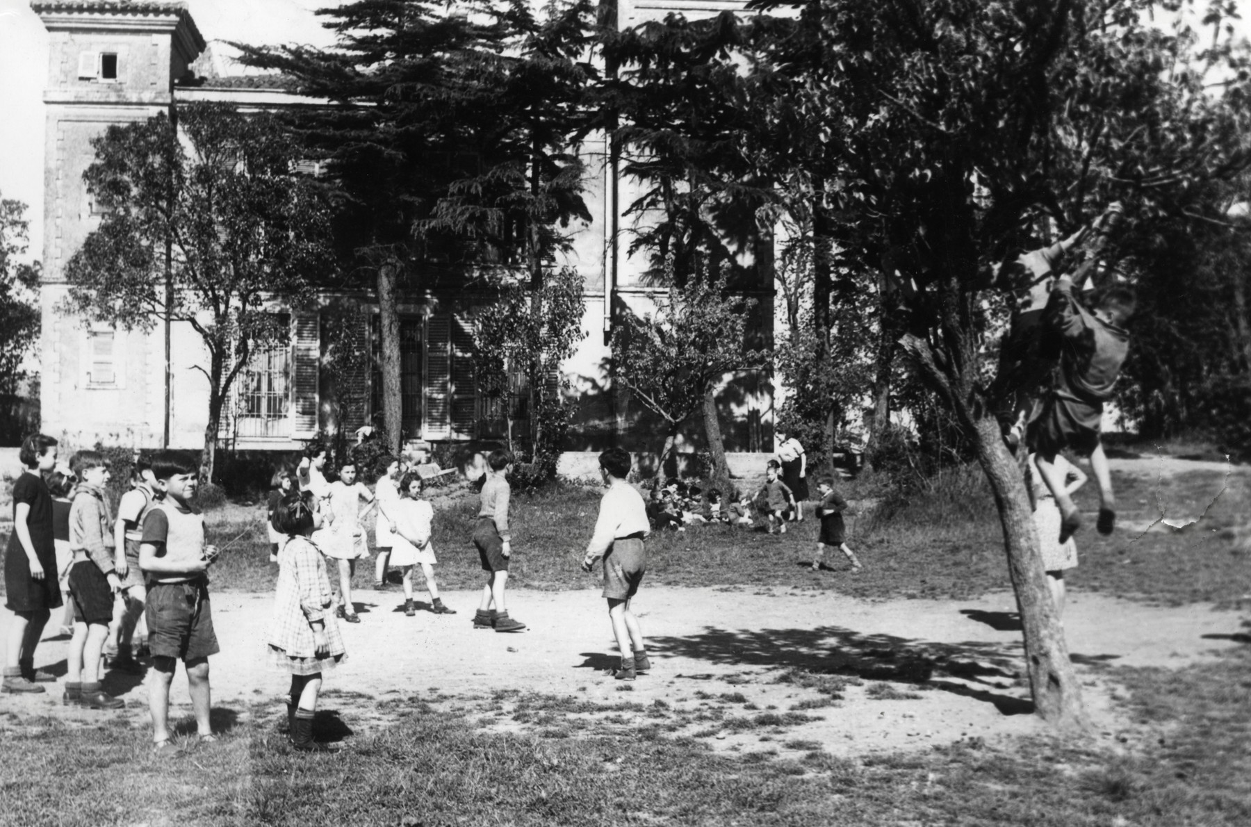 Children play in the field at Chateau de Larade.
