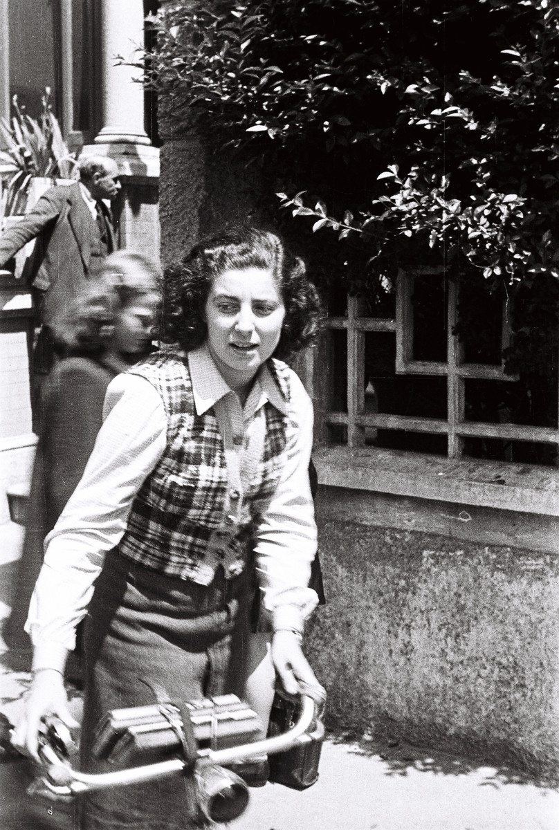 Nora Heinebach, a student at the Jewish school in Milan, rides her bicycle.