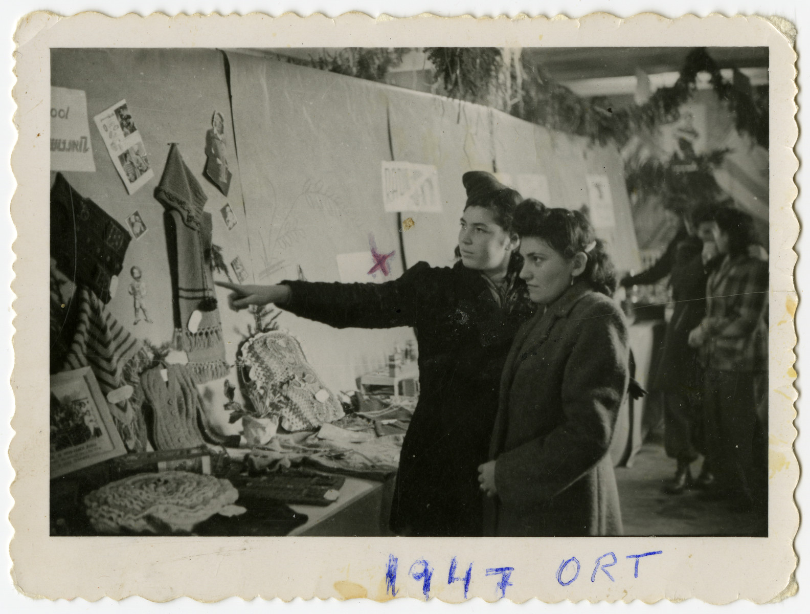 Sally Korn and a friend view a display of knitwear in the ORT exhibition in the Foehrenwald displaced person's camp.