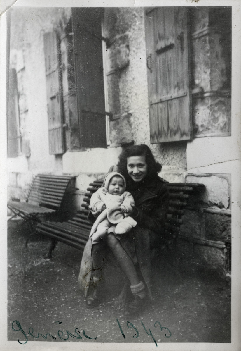 Annie Spira holds her baby brother Serge after arriving in Switzerland.