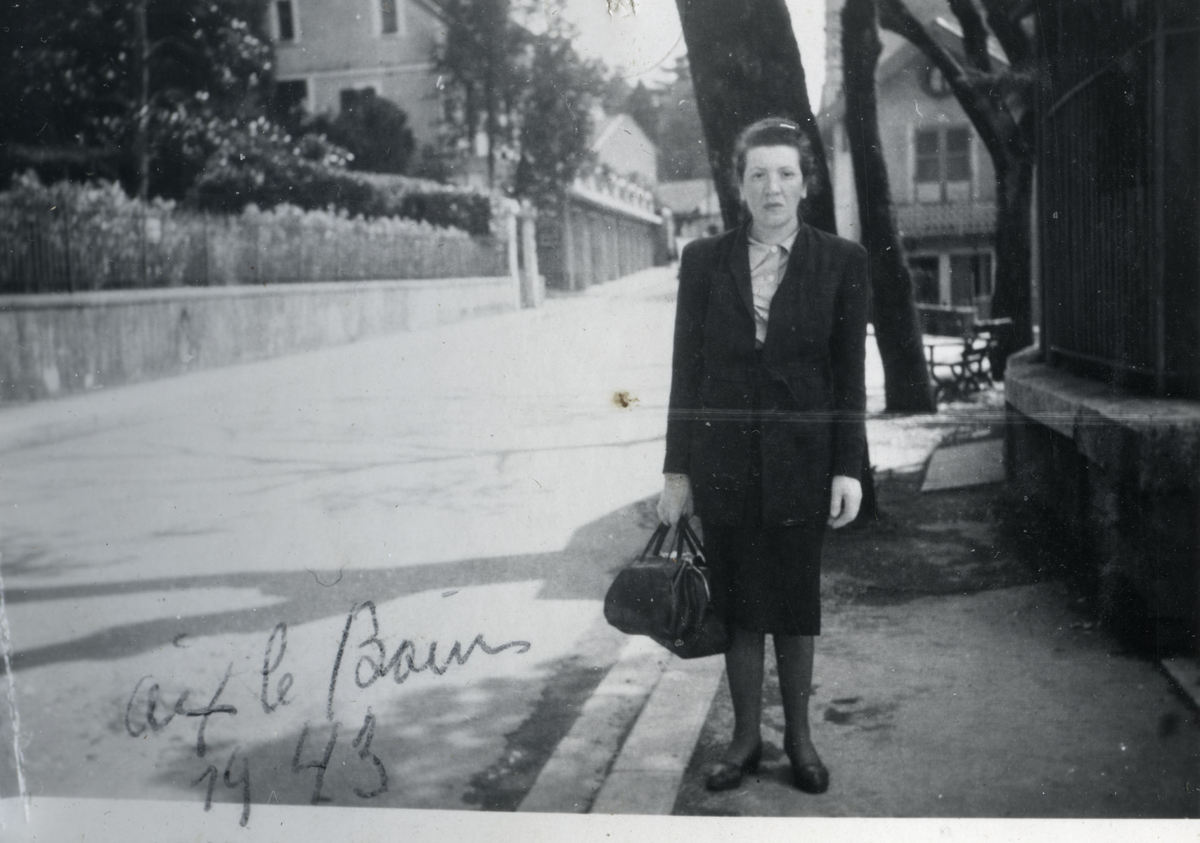 Camille Spira stands on a street in Aix-les-Bains.