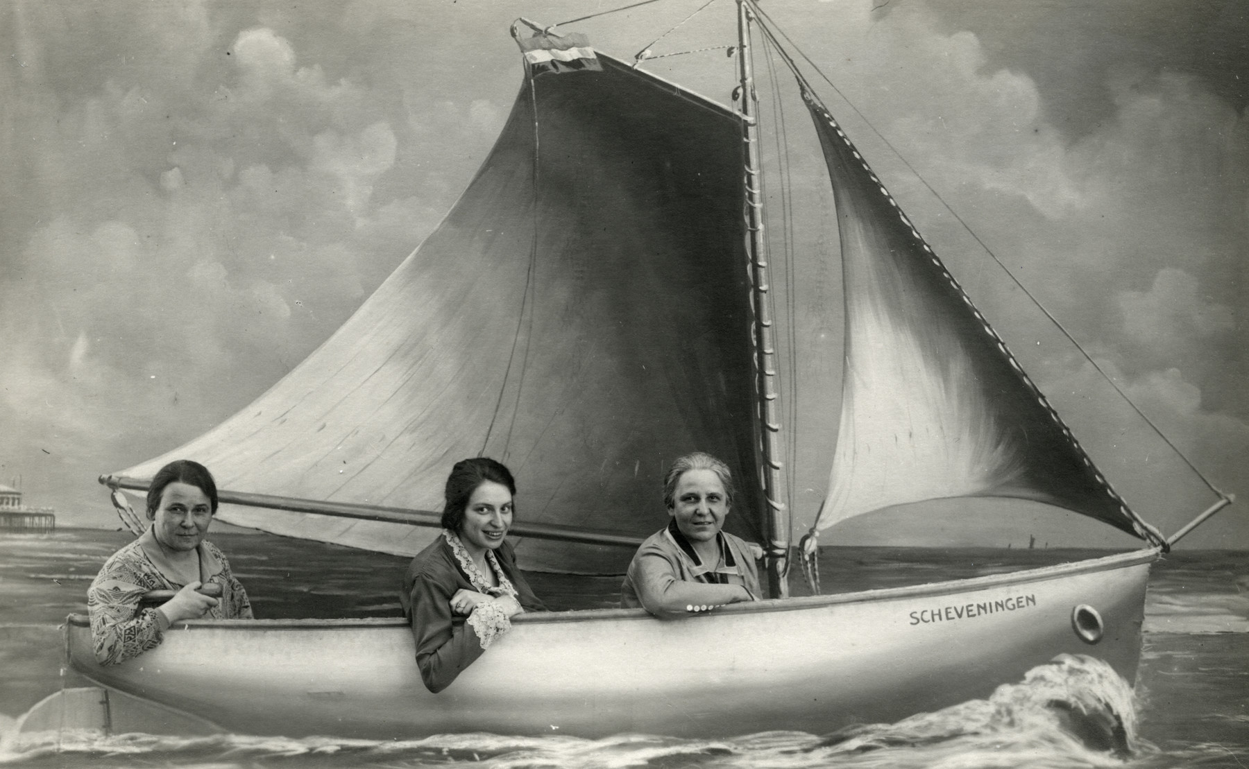 Studio portrait of three sisters on a pretend boat in Scheveningen, Holland.  Lotte van Collem Randerath is in the center.