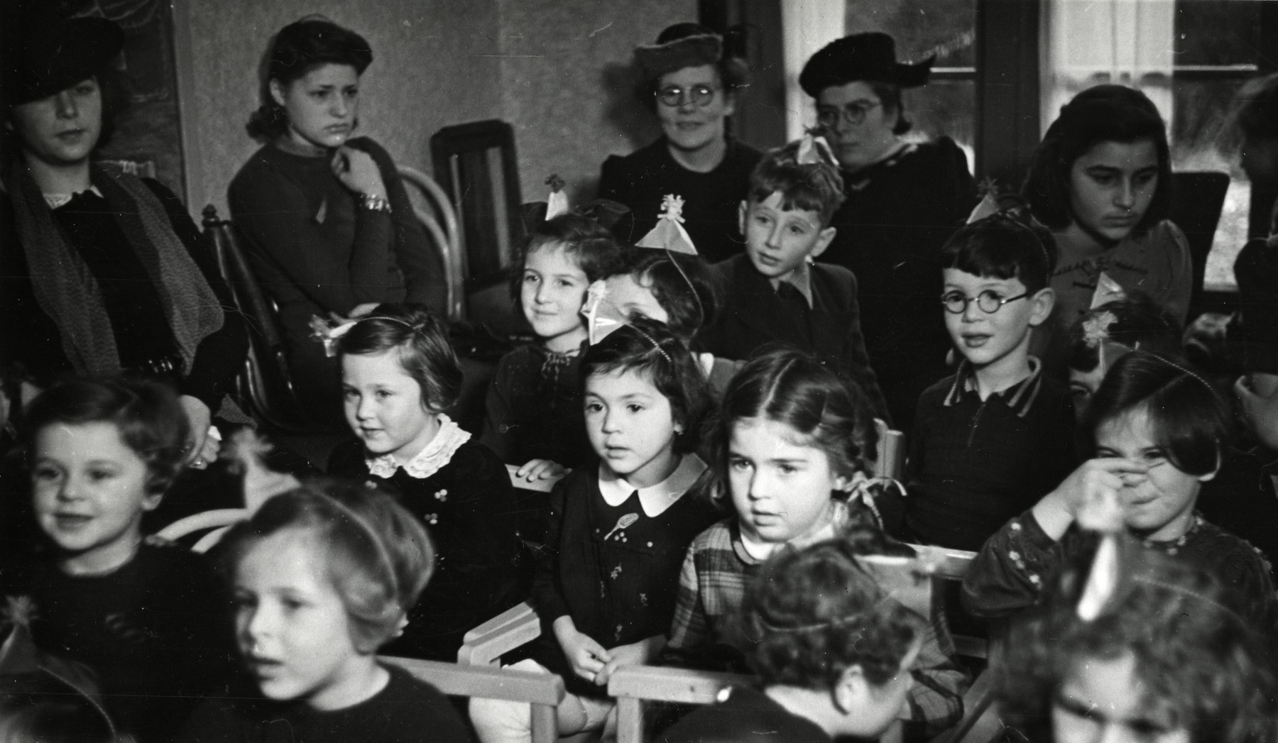 Young children attend a Hanukkah celebration in the Jewish school in Amsterdam.