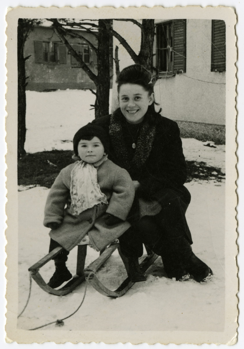 Sally Korn takes Abbie Fegerman sledding in the Foehrenwald displaced person's camp.  Abbie Fegerman was the son of friends in Foehrenwald.