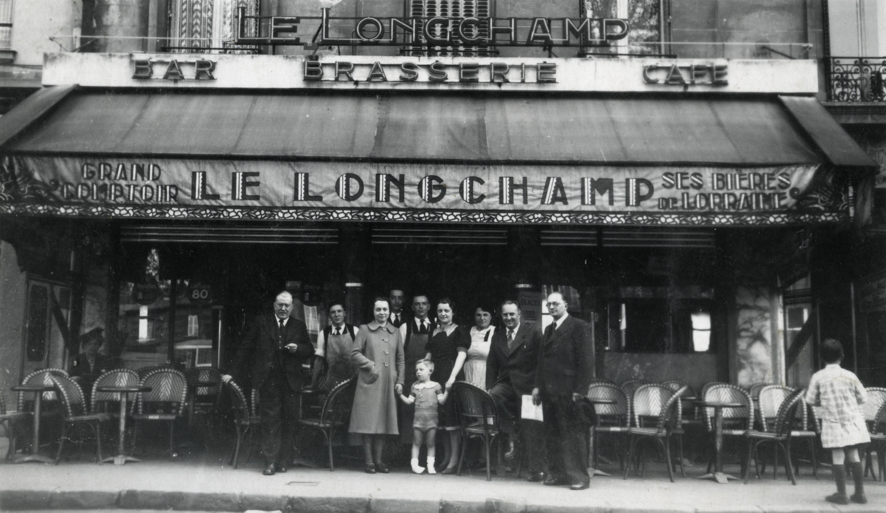 A group of friends poses outside a cafe in Paris.  Eduard Spira is pictured on the left.