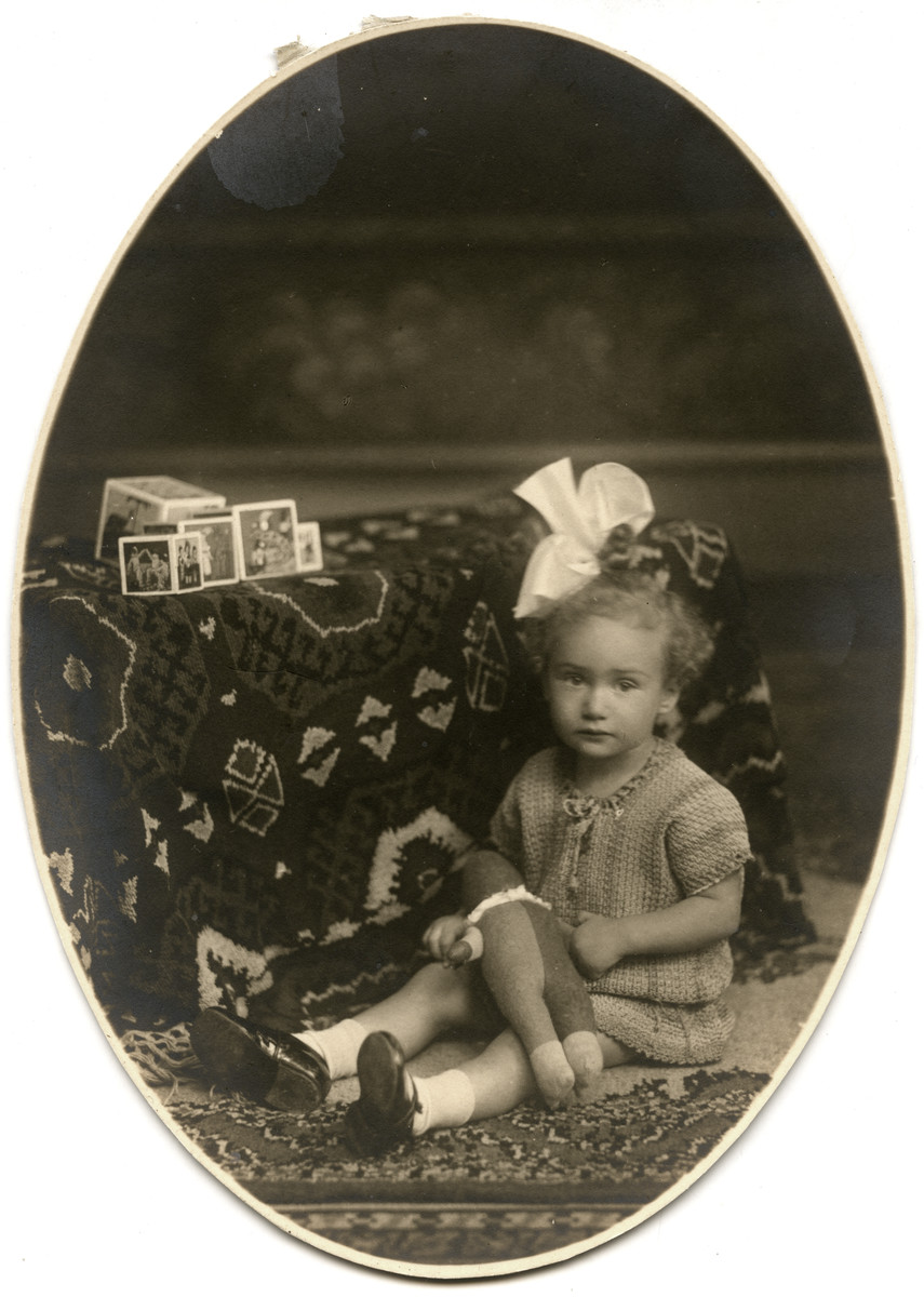 Four-year-old Marta van Collem poses with a stuffed animal.