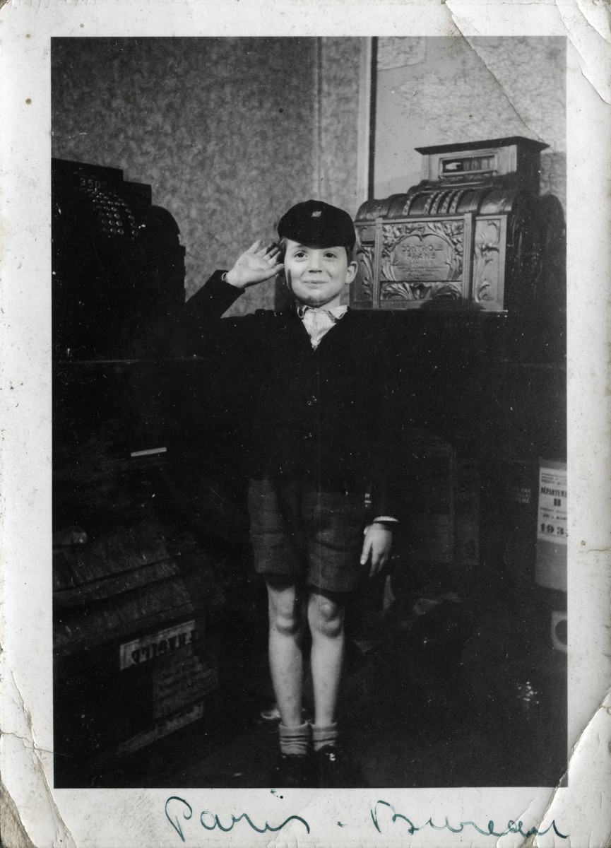 Max Spira gives a salute in the office of his father's cash register company.