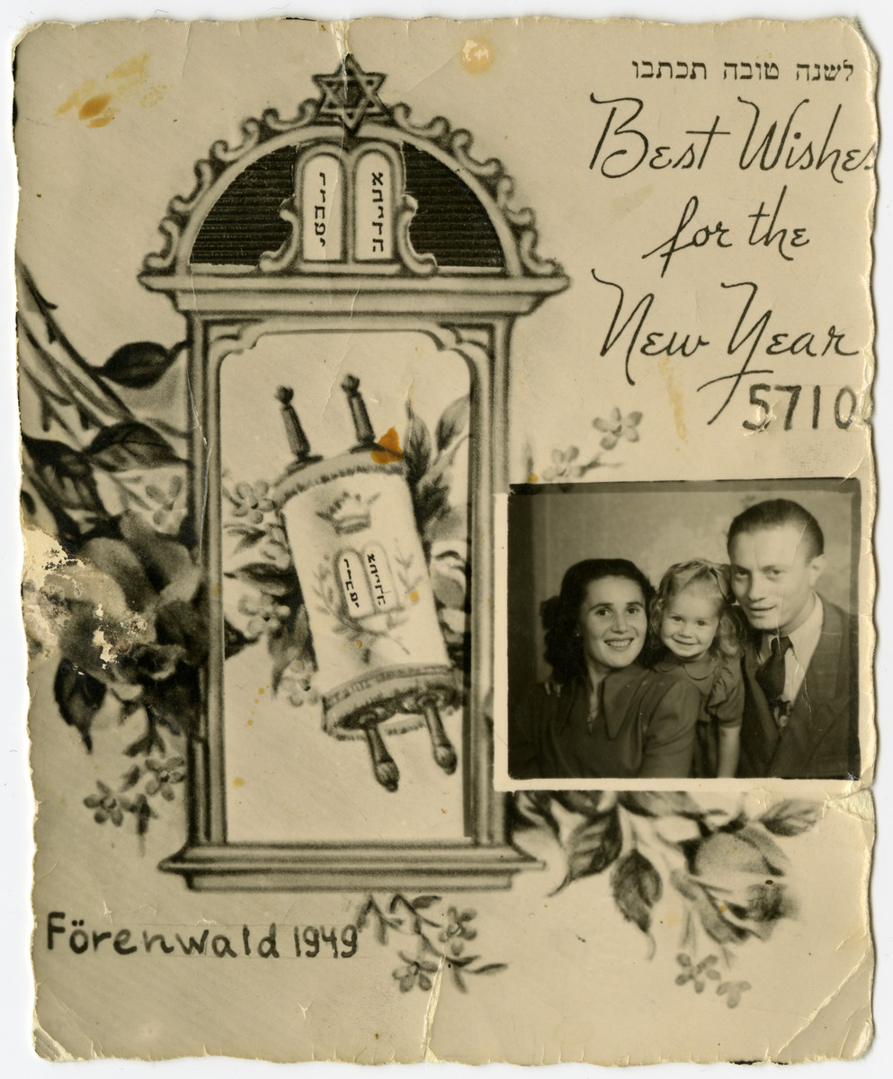 Jewish New Years card with an inserted photograph of Sally and Leon Korn and their young daughter.