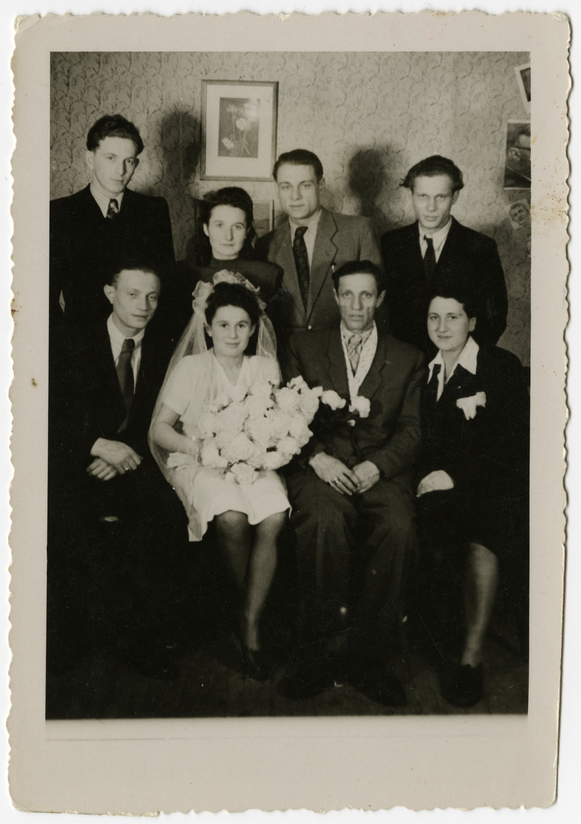 Group portrait taken at the wedding of Leon and Sally Korn in the Foehrenwald displaced person's camp.  Pictured in the front row are Leon, Sally and Leon's uncle, Moses Korn (seated second from the right).
