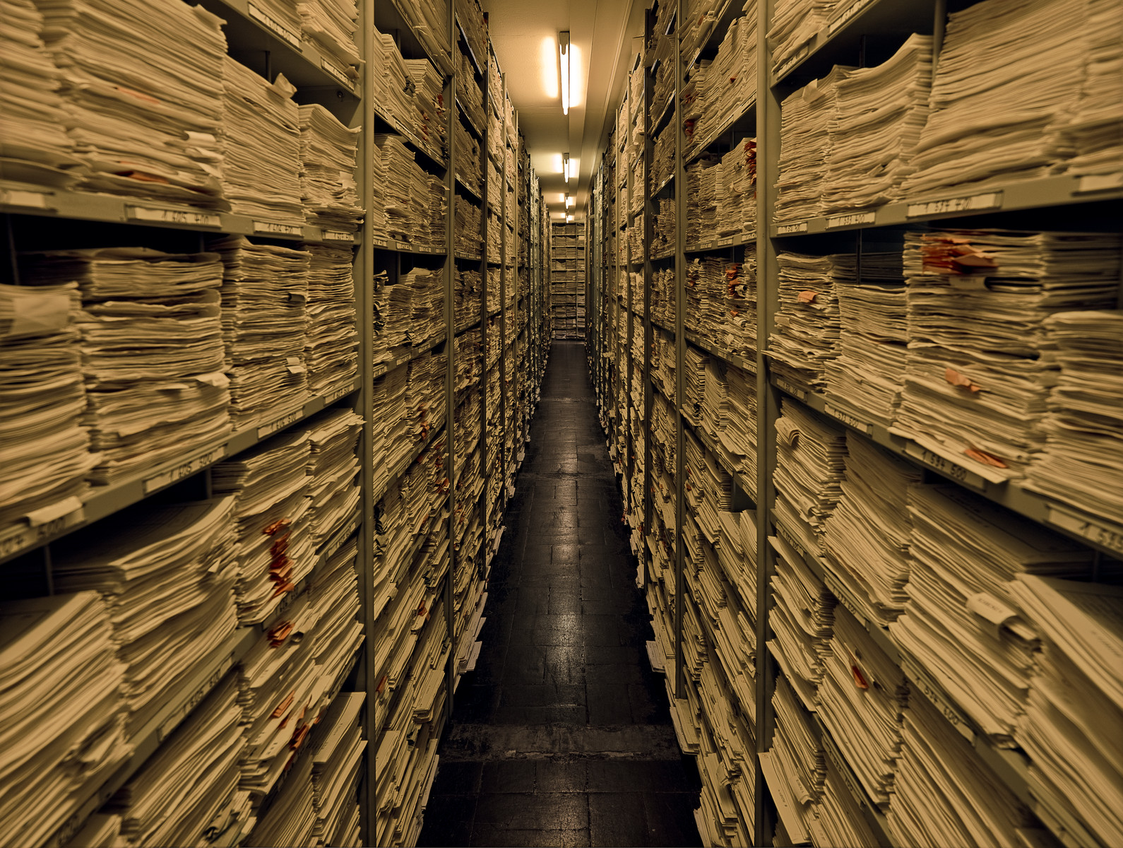 View of the Processing Unit of the International Tracing Service.    These shelves on the right and left-hand sides of a long hallway contain the records of over 61,000 enquiries.