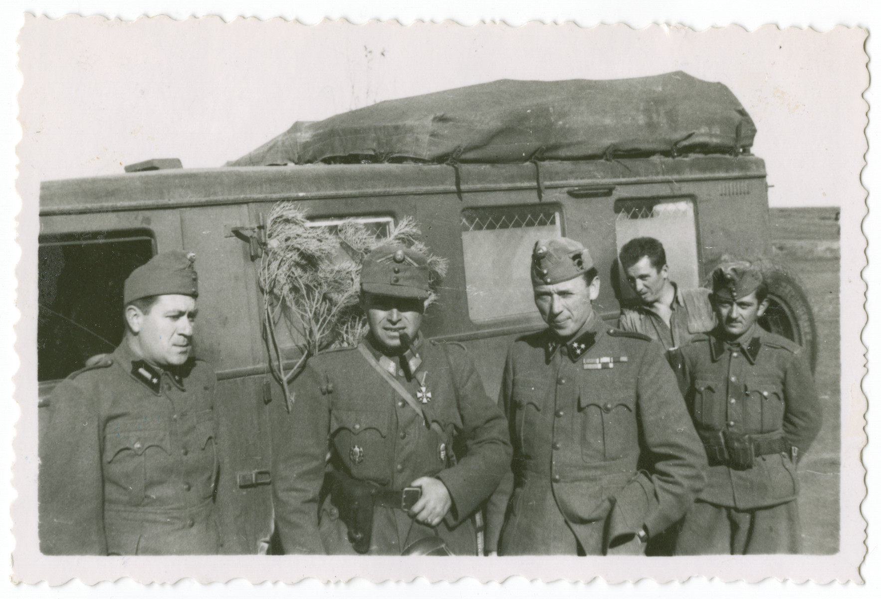 Karoly Deme, third from the left, poses among other members of the Hungarian 20th Infantry Division.
