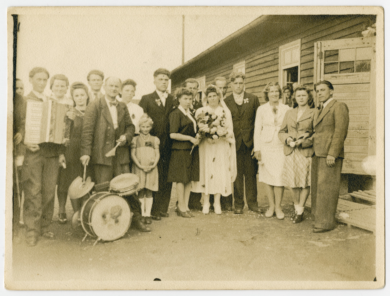 A wedding party in the Schwarzenborn displaced persons camp.  Among those pictured are the bride, Helene Cenkar Bodakowski, and the groom, Jan Bodakowski.