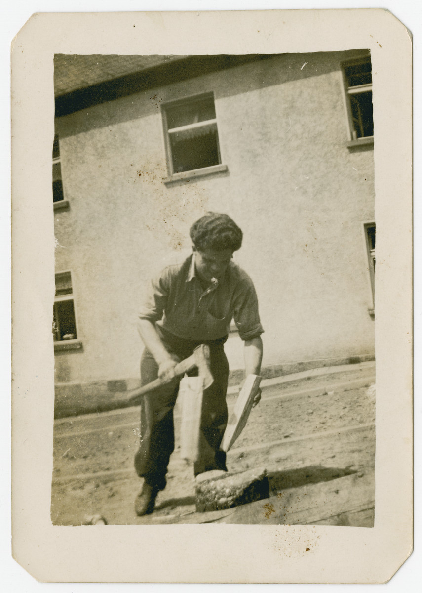 Jan Bodakowski chops wood at the Wildflecken displaced persons camp.