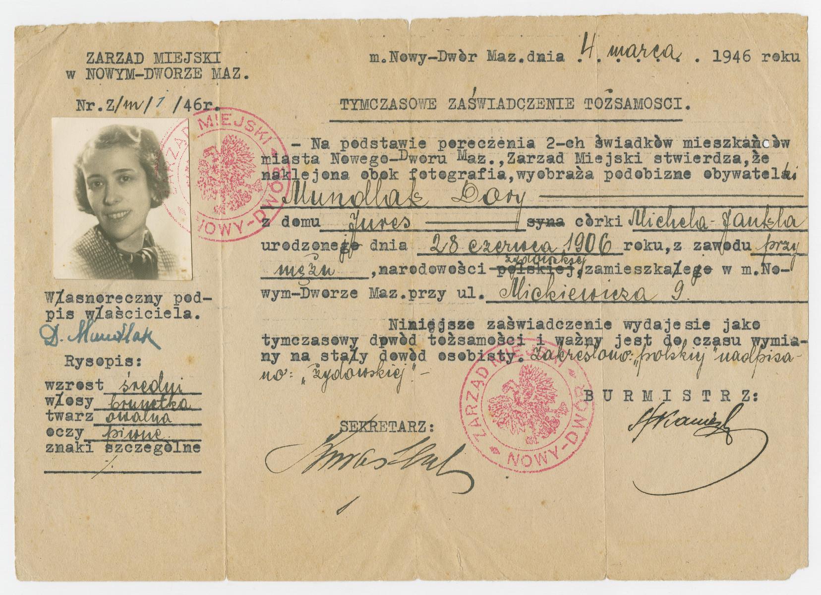 Postwar identification document issued to Dora Mundlak in Nowy Dwor, Poland.