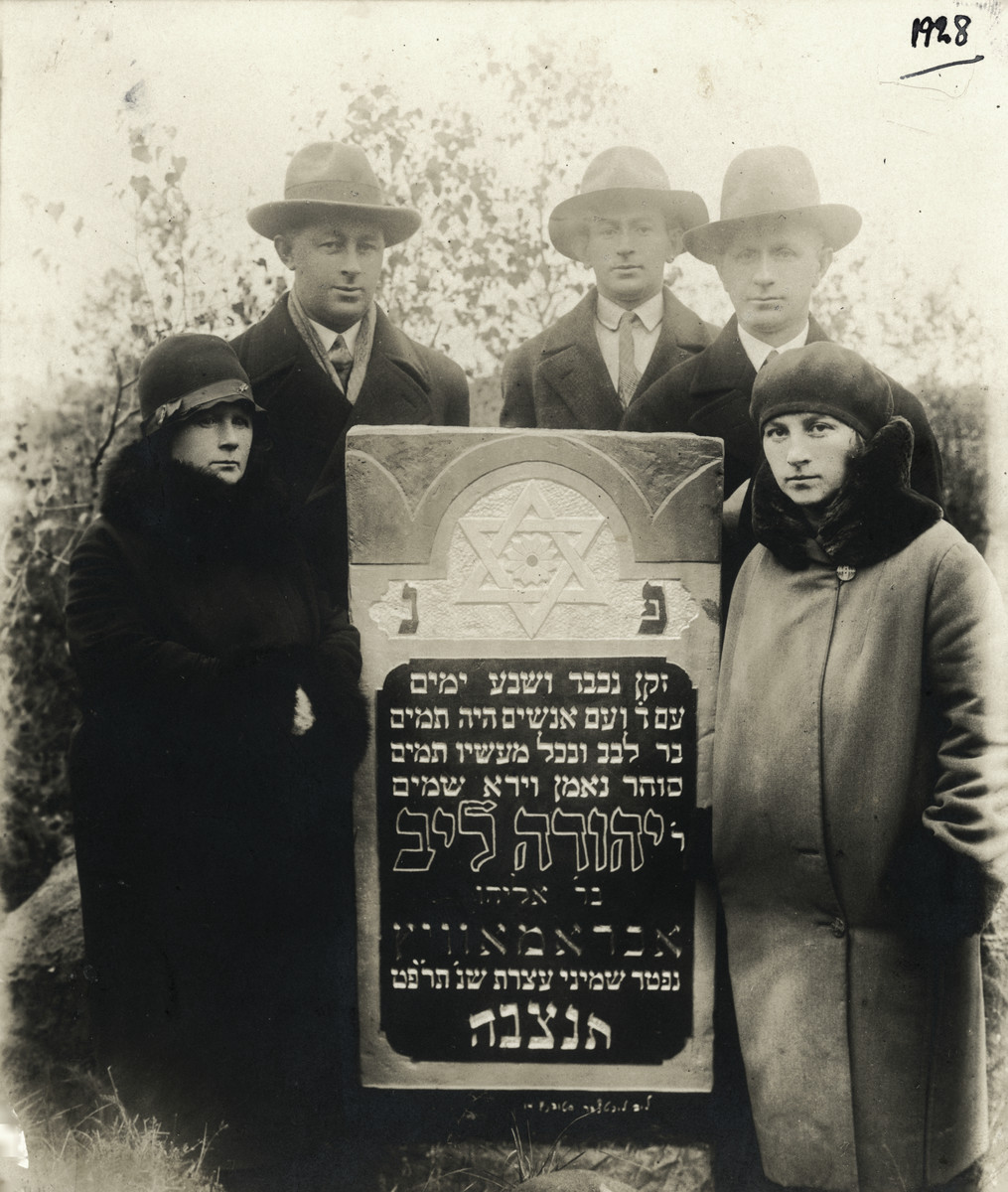 The Abramovitch family poses by the grave of their father, Yehuda Leib Abramovitch who died on the Jewish holiday Shemini Atzeret in 1928.  From left to right are Ziporah (Faygel), Simcha and Tsalke Abramovitch.