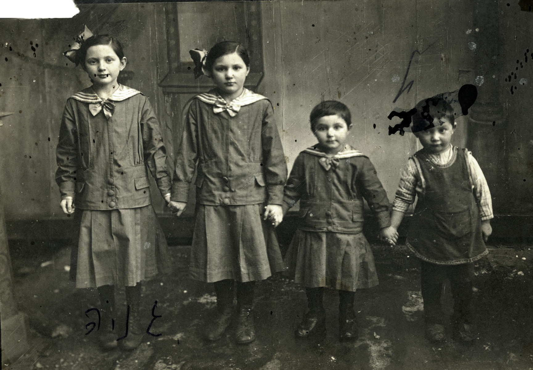 Studio portrait of the four oldest Volovelski children.  From left to right are Genya, Scheinche, Sara, and Moshe.