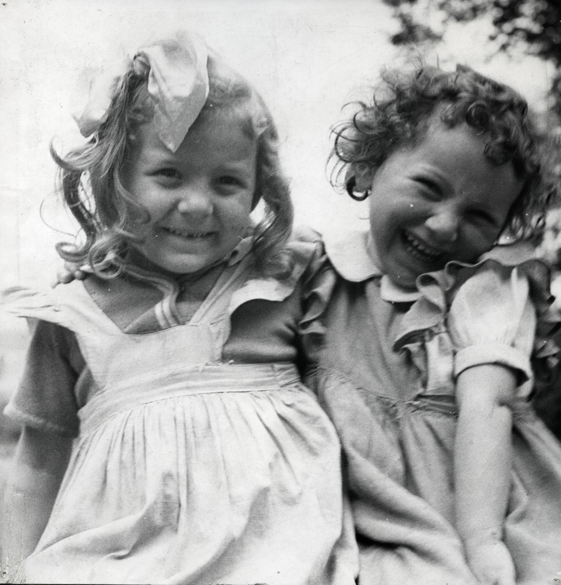 Close up portrait of two young girls in the Foublaines children's home.   Ewa Margules is on the left.