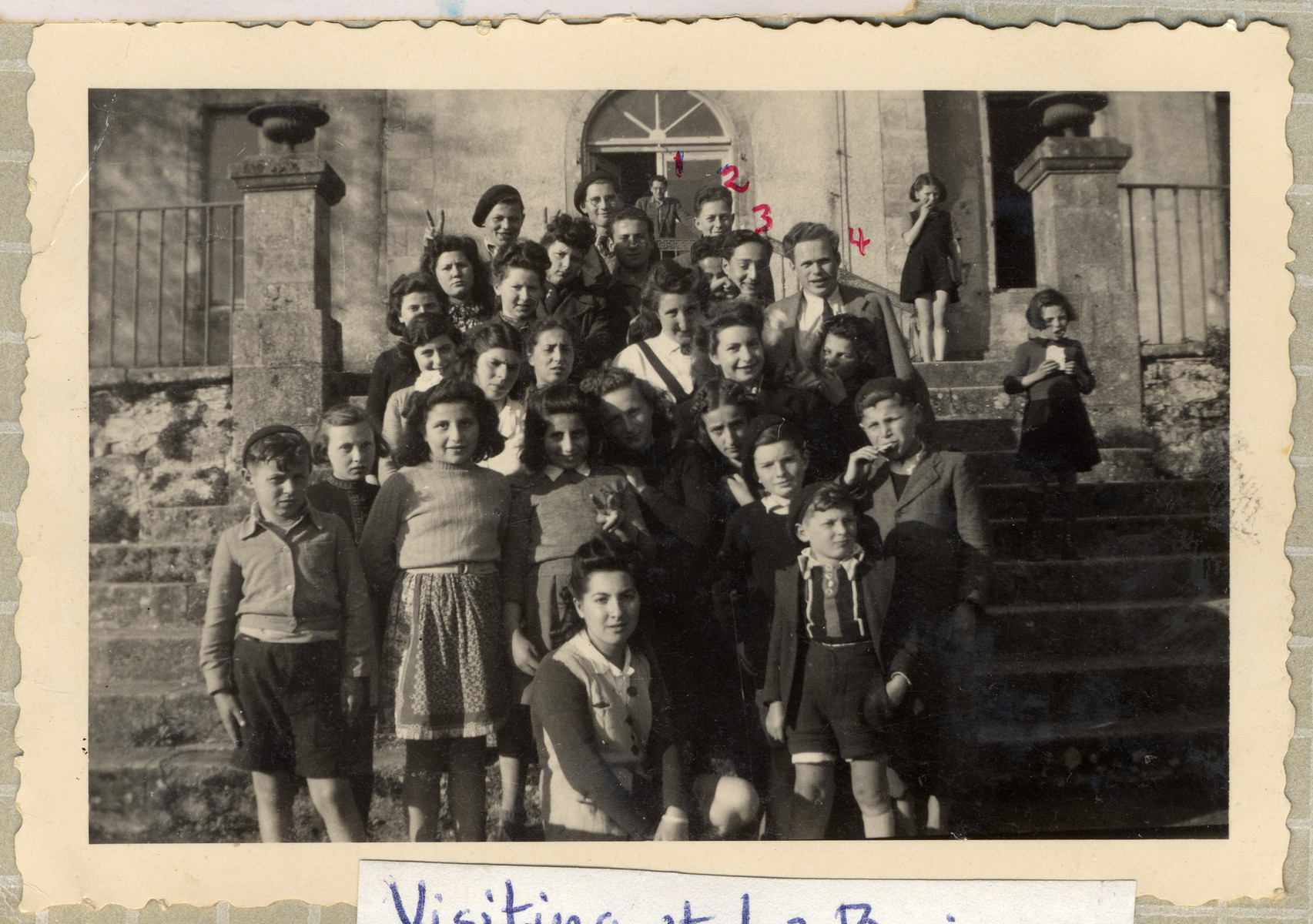 Group portrait of Jewish DP youth outside the Chateau La Borie children's home in Limoges.  Among those pictures are Ruth and Hugo Zarnicer and Herbert Karliner.