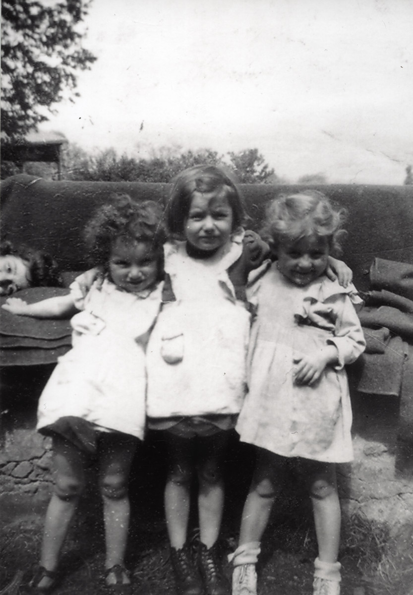 Three young girls pose together in the Foublaines children's home.  Ewa Margules is on right,  Ruth Rosenfeld is pictured in the center.