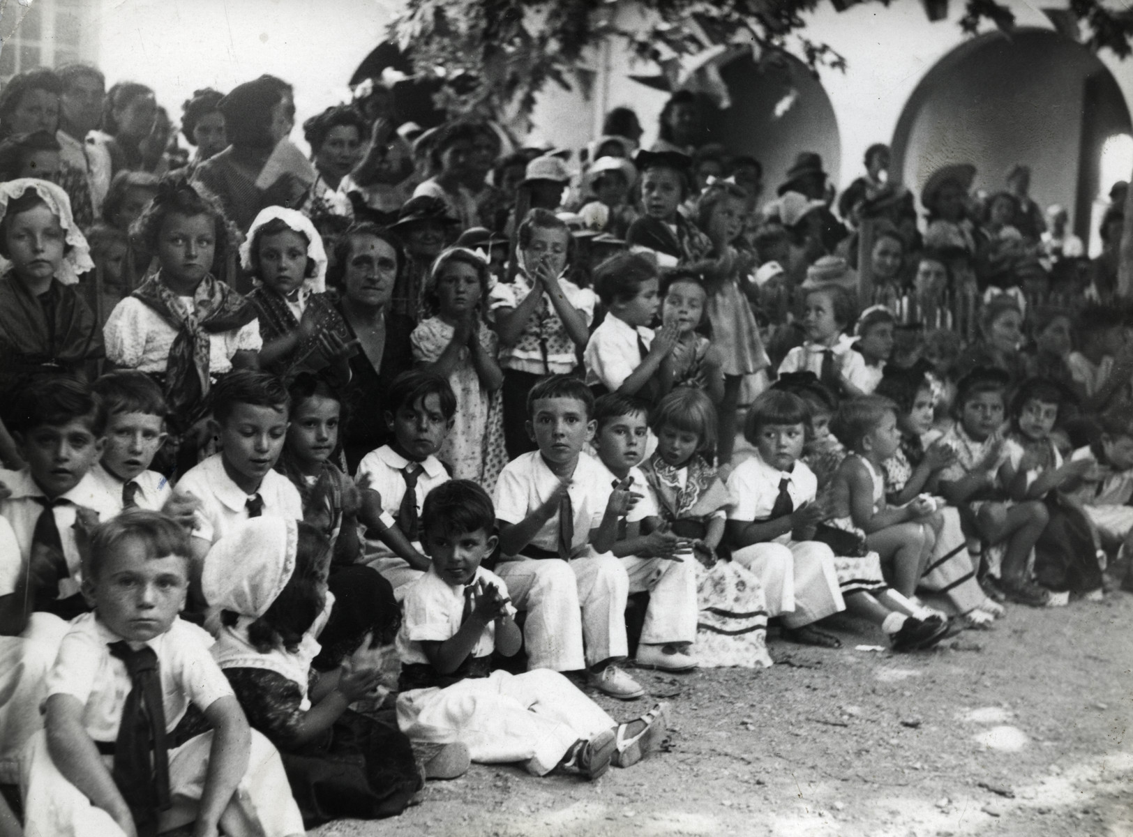 A group of young children in costume gather on the Blvd. Victor Hugo in Bandol, France.  Joseph Schreiber is pictured in the second row, second from the left.