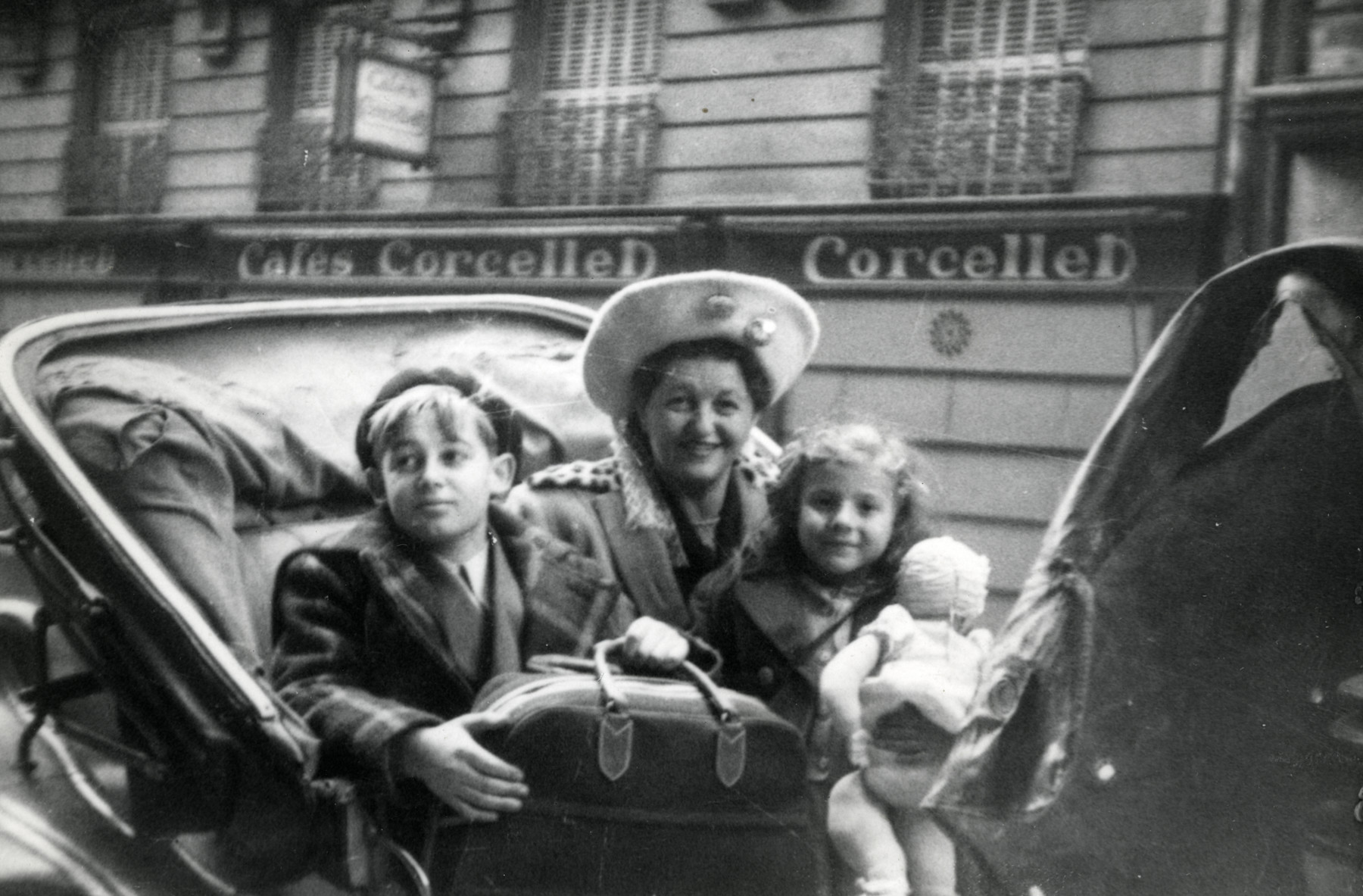 Gerdie Gartenberg takes her two newly adopted children, Ewa and Jacob, in a carriage ride through Paris prior to bringing them to the States.