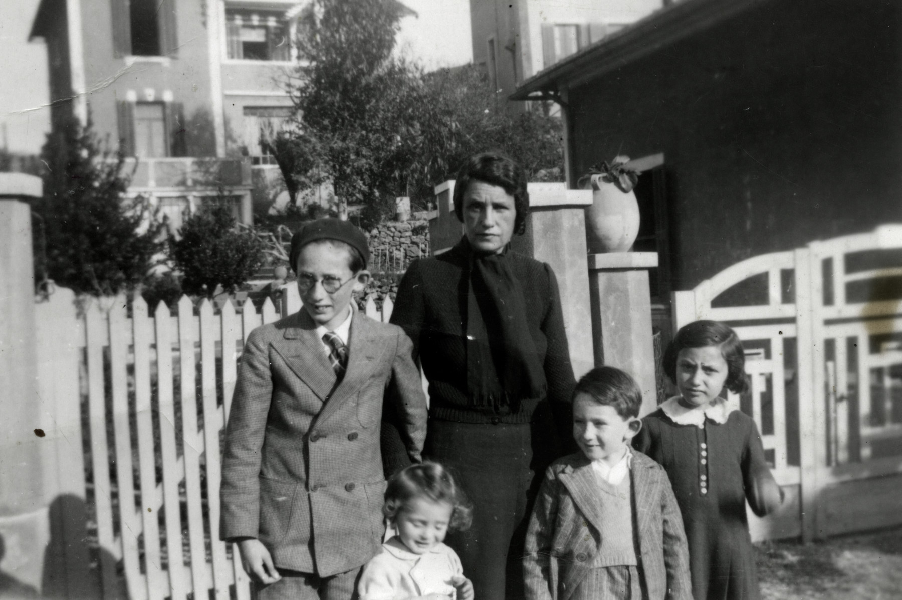 Portrait of the Schreiber family in southern France.  From left to right are Raphael, Binyamin, Joseph and Myriam.  Their mother Fanny Schreiber is standing behind them.