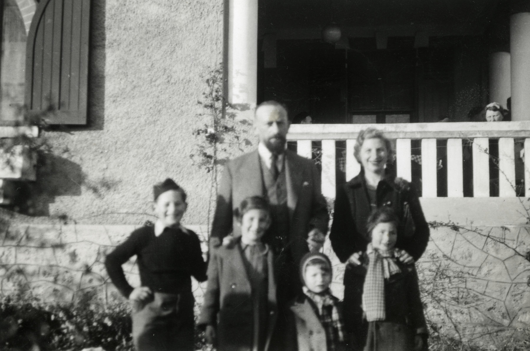 Gustav Schreiber (the uncle of the donor) poses with his wife and children.  Pictured in front are Rene, Lucie, Nicole and Henri.  Behind them are Gustav and Hella Schreiber.