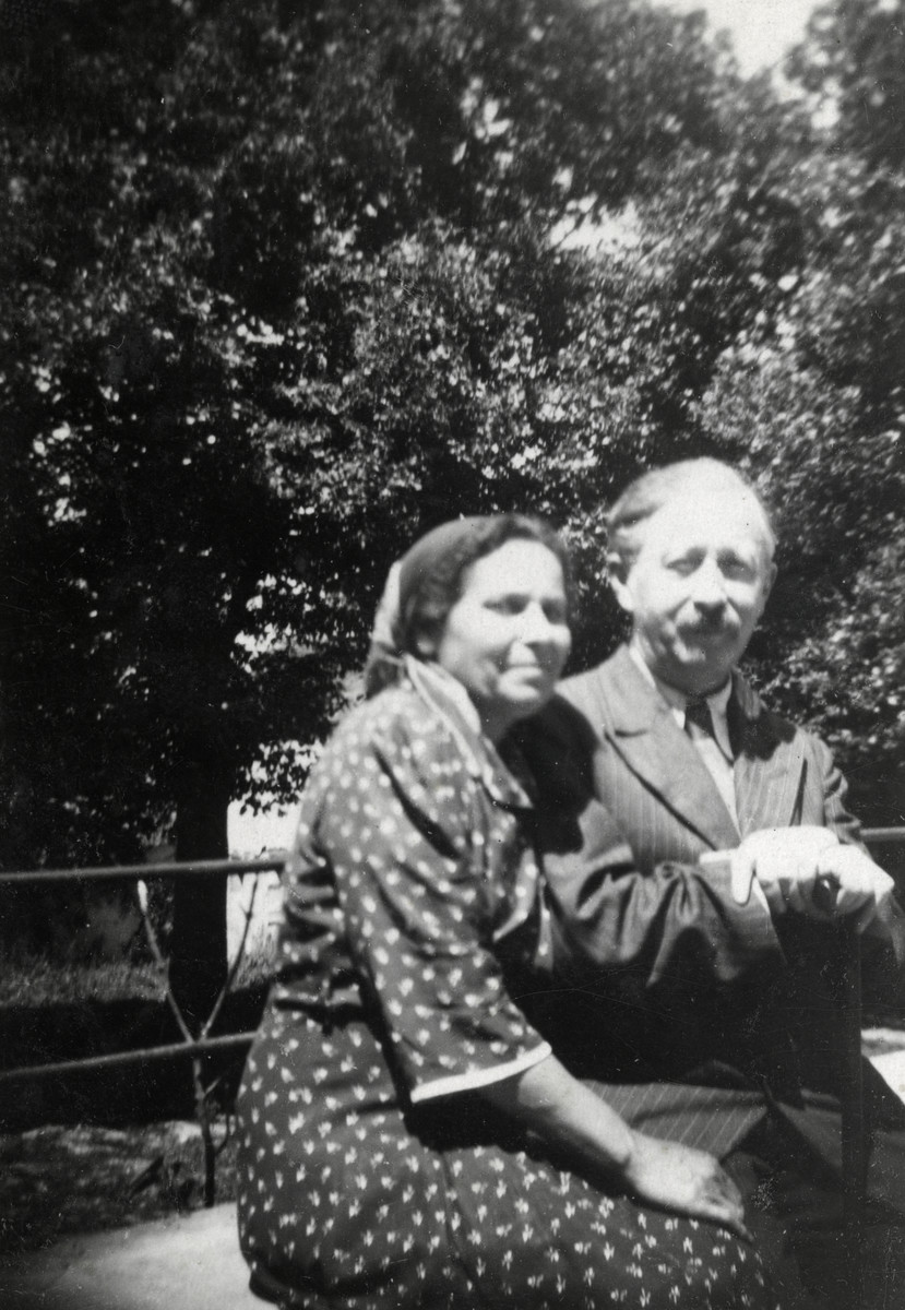 Dr. and Mrs. Josepovitz, the directors of the Fublaines Children's Home, sit on a bench outside the home.