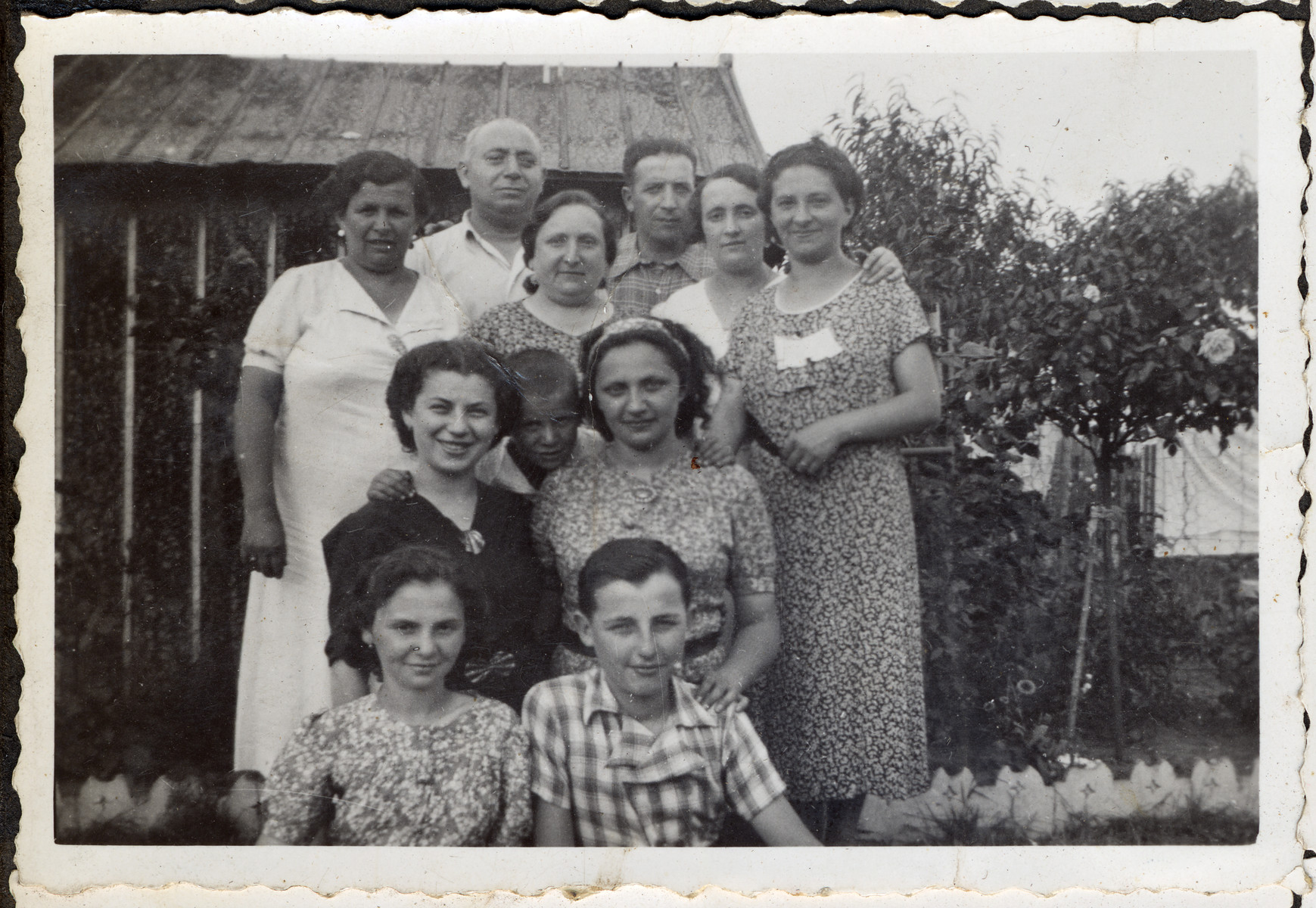 Group portrait of a prewar Jewish family [possibly in Sighet].  This is one photograph from the album of Rosalia Dratler Roiter.  She later was deported to and perished at Auschwitz.