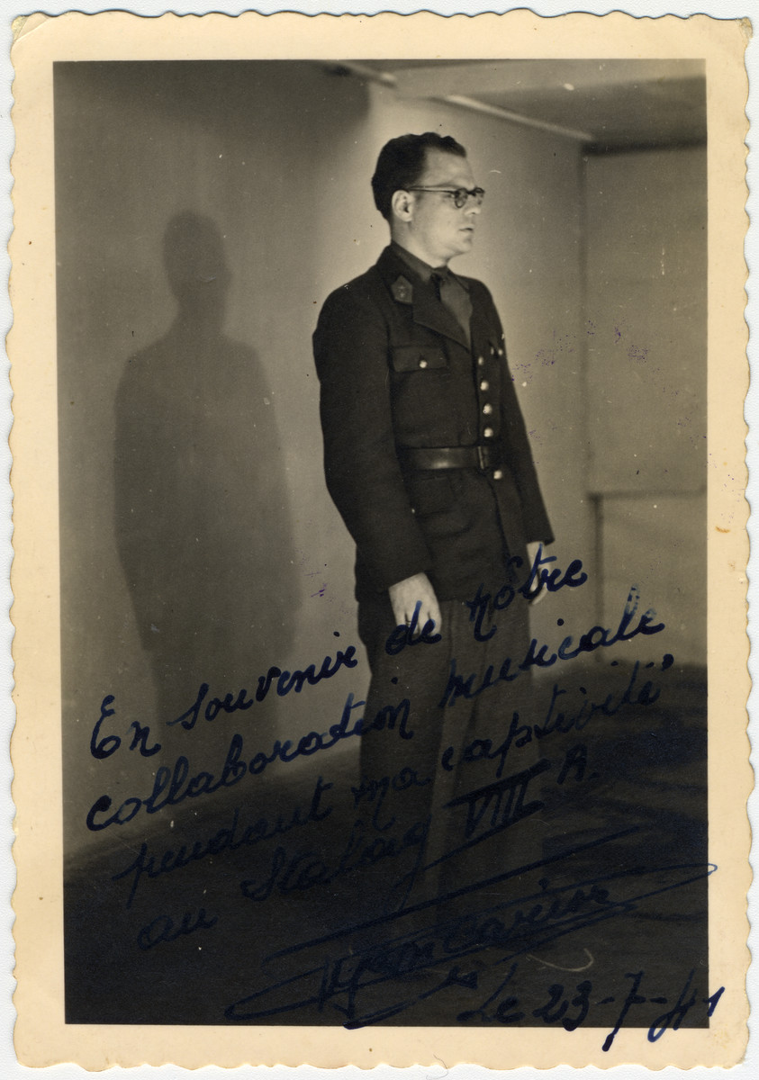 """Close-up portrait of Ferdinand Carrion, a Belgian musician and prisoner-of-war.  He conducted the prisoner's orchestra in Stalag VIII-A.  The original caption reads """"As a memory of our musical collaboration during our custody in Stalag VIIIA."""""""