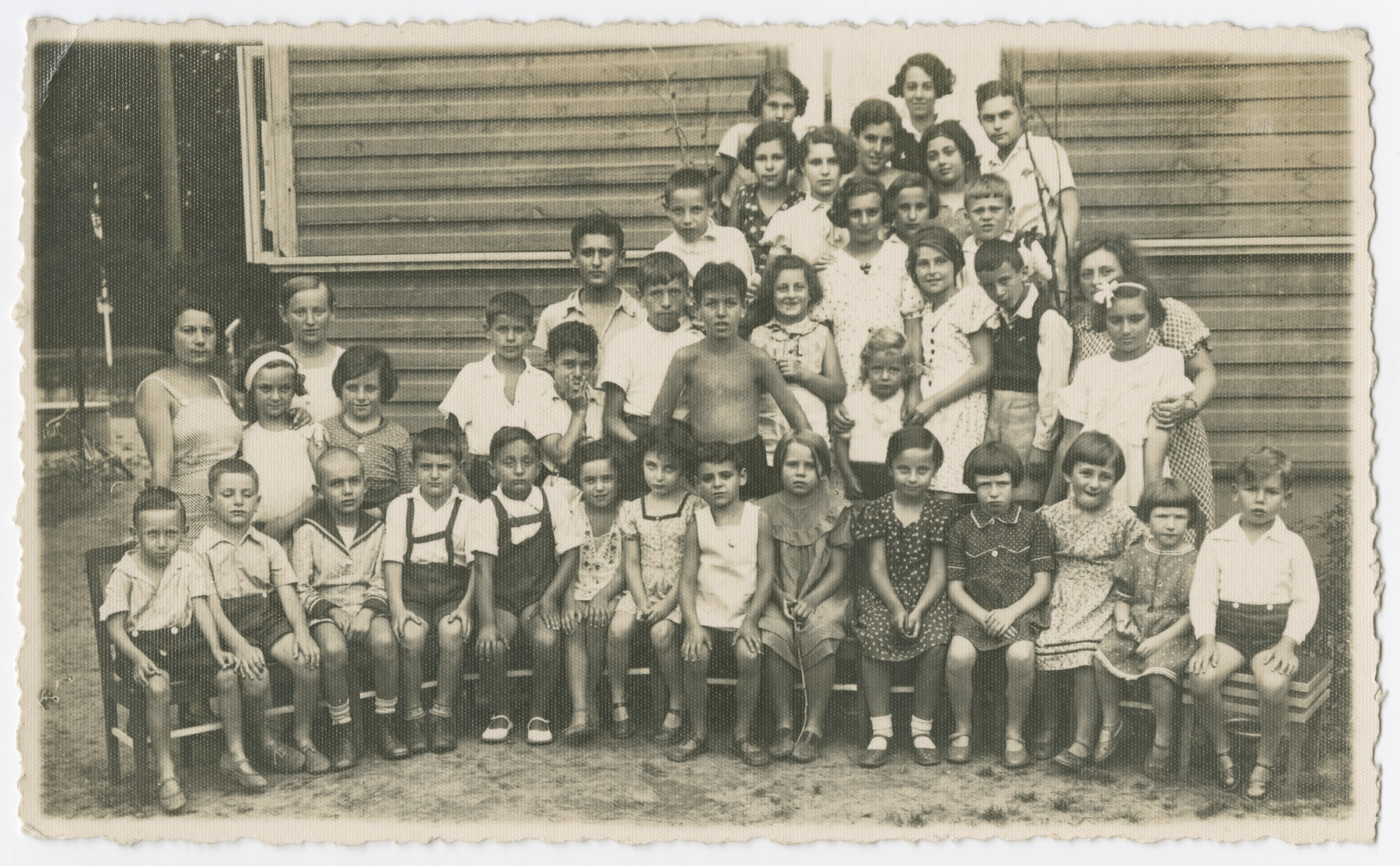Class portrait of elementary school children outside of the [school].
