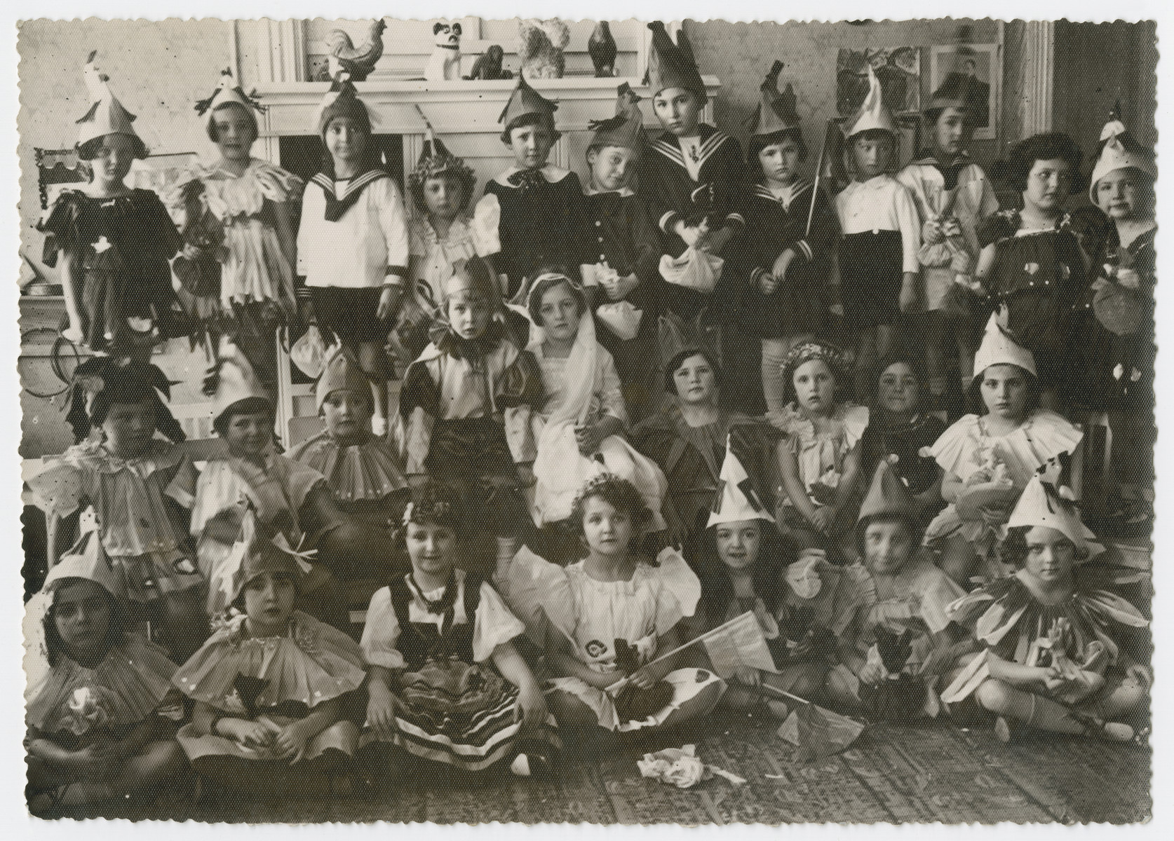 A group portrait of children dressed up in [Purim] costumes.