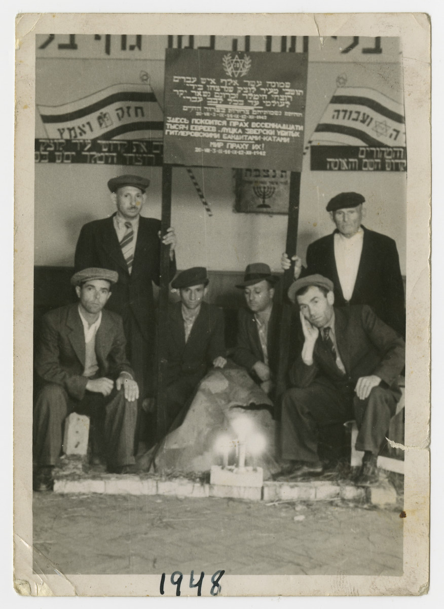 Jewish men hold a memorial service to the murdered victims from the town, Luck (Lutsk).