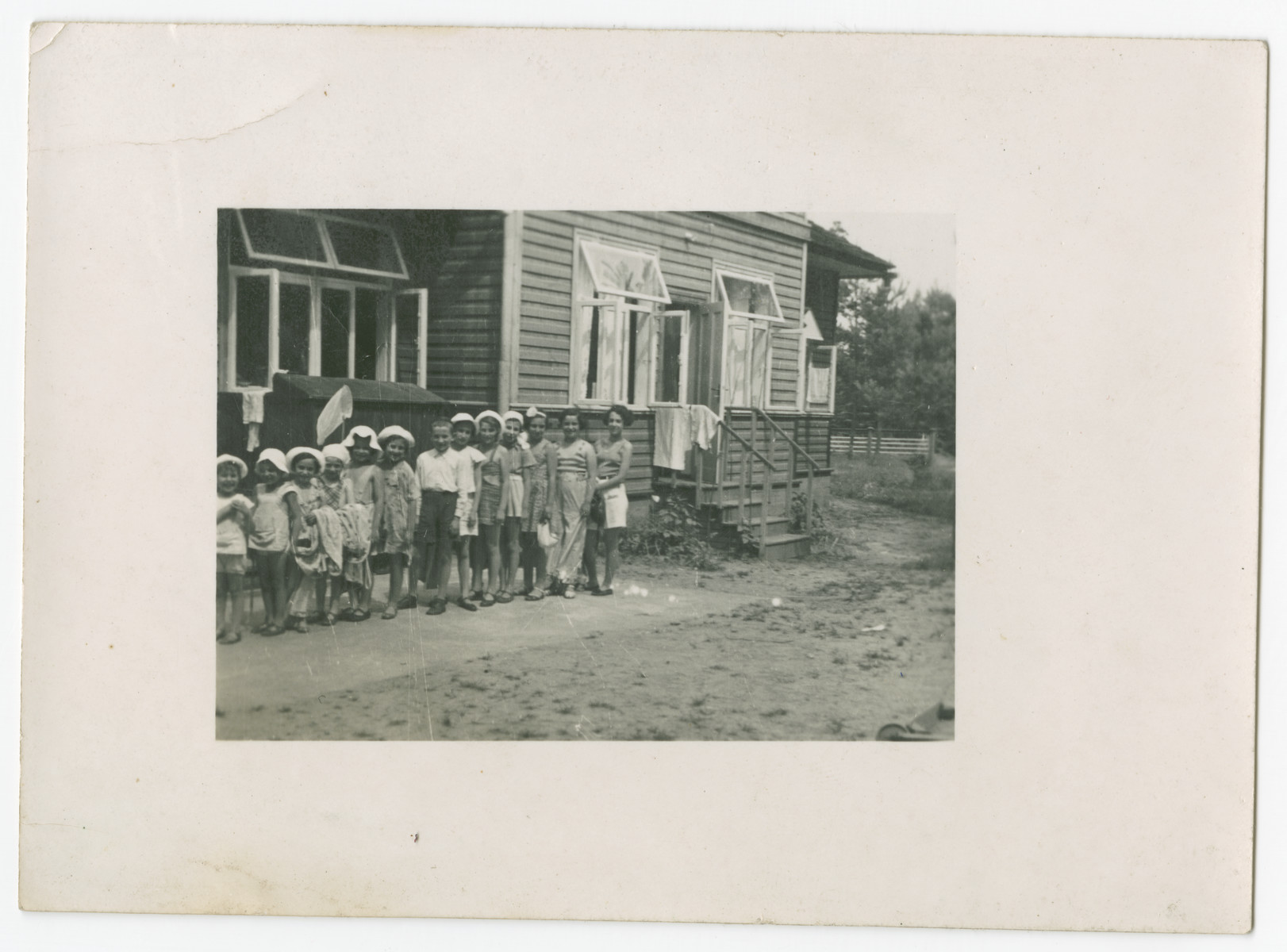 A group of school children line up outside a [school].