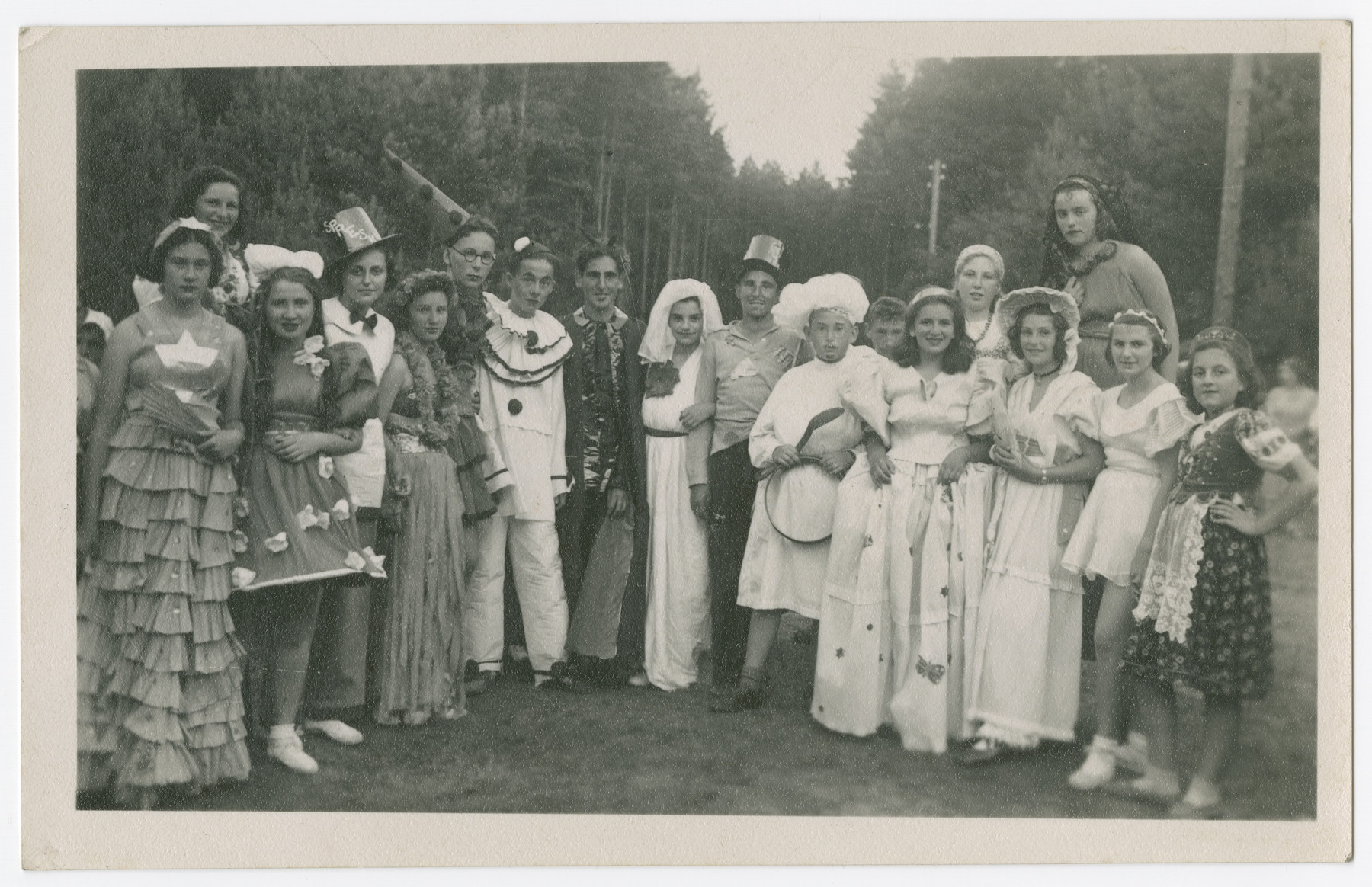 A group of teenagers dressed in [Purim] costumes.
