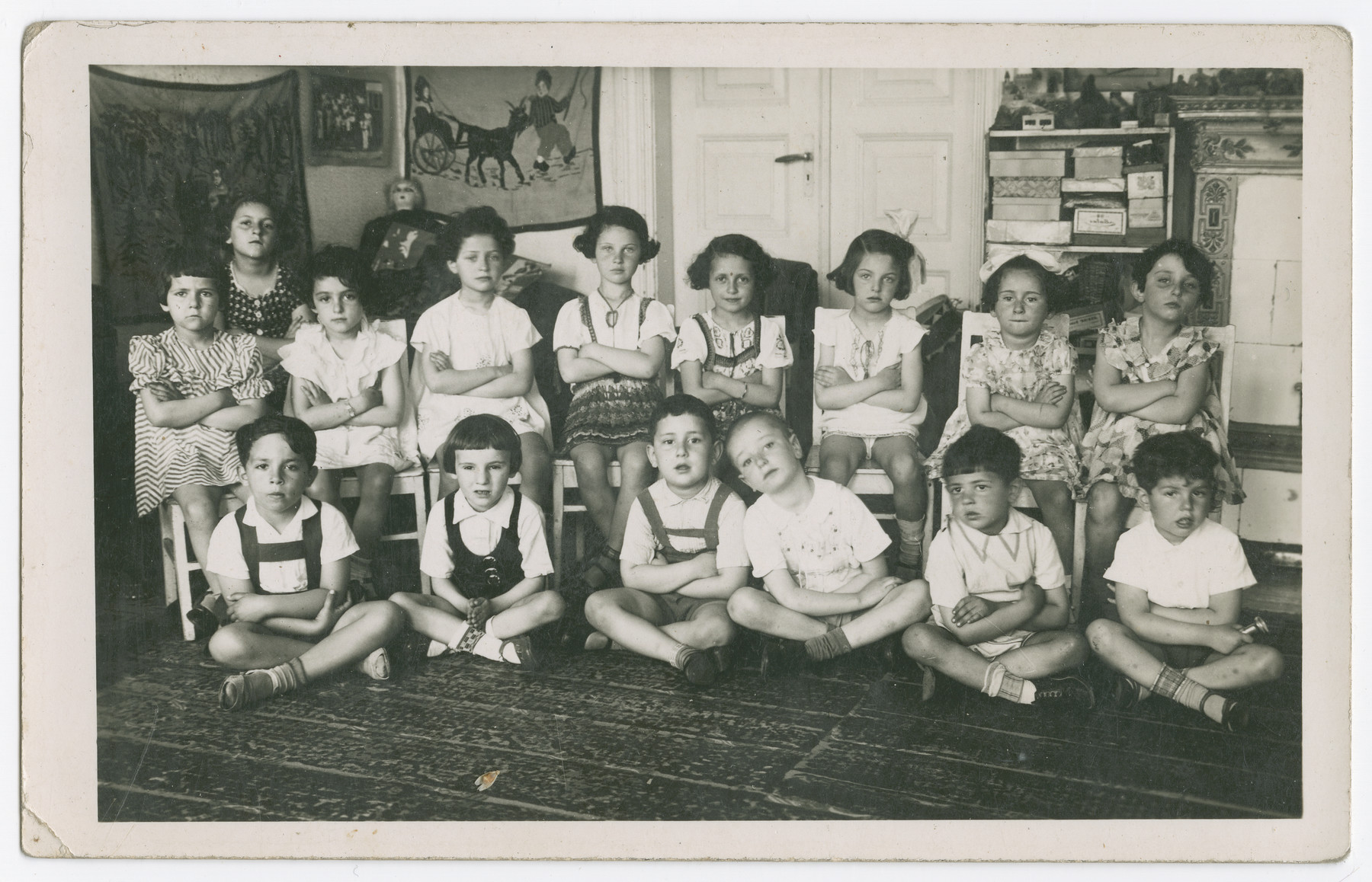 Class portrait  of young children inside of a [school].