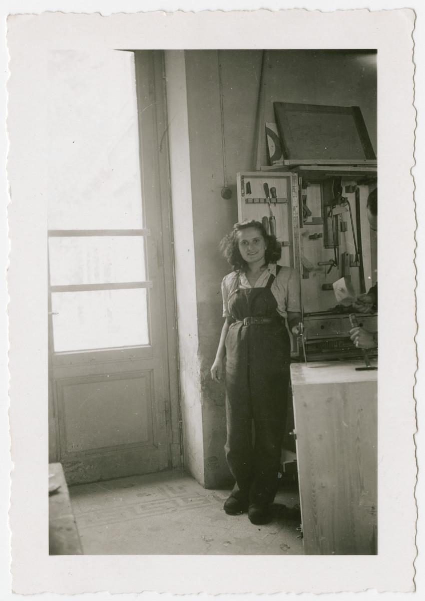 Eva Weinberger poses next to the tool box in a kibbutz hachshara near Bern.