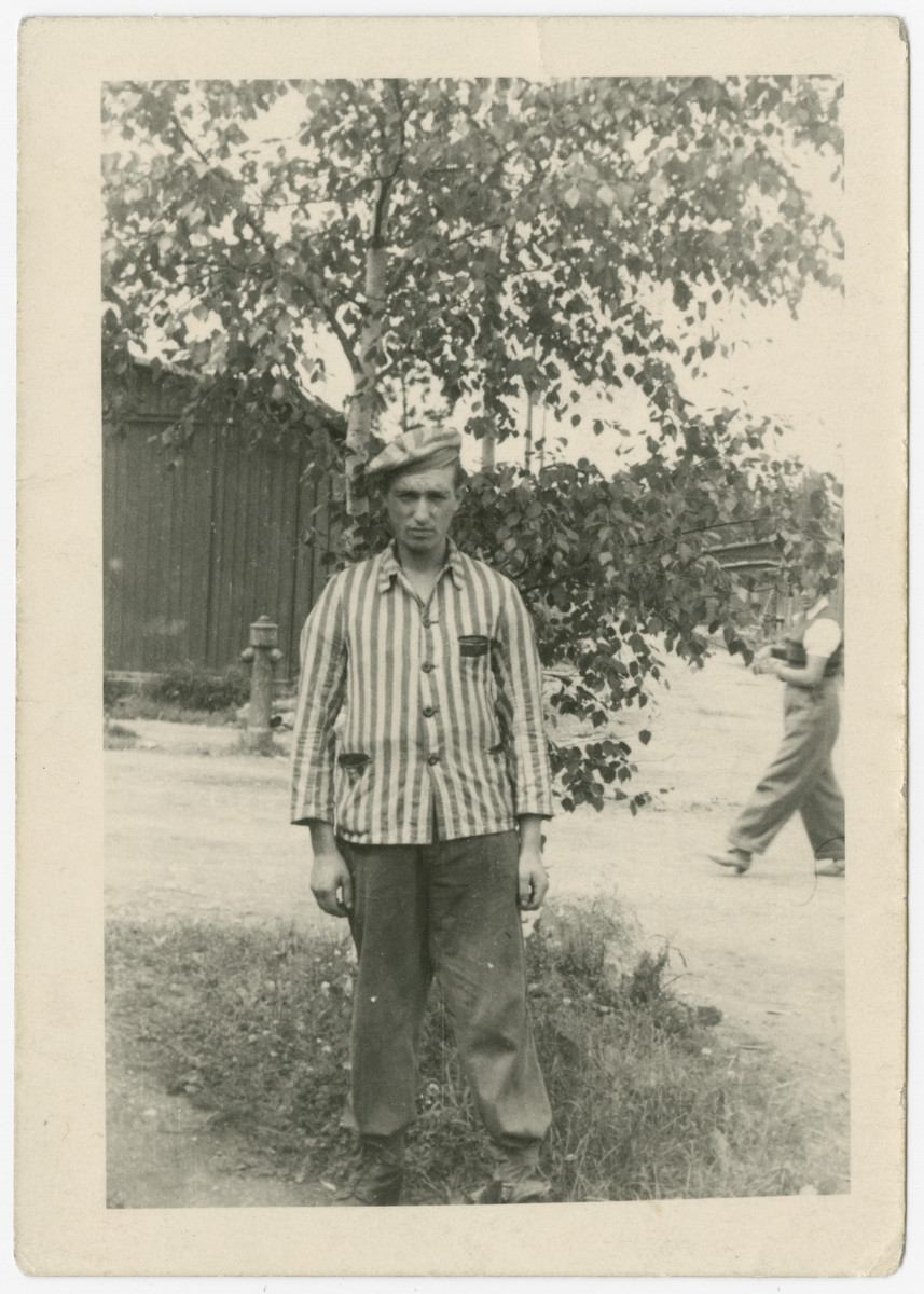 Gershon Press poses after the war in his concentration camp uniform.