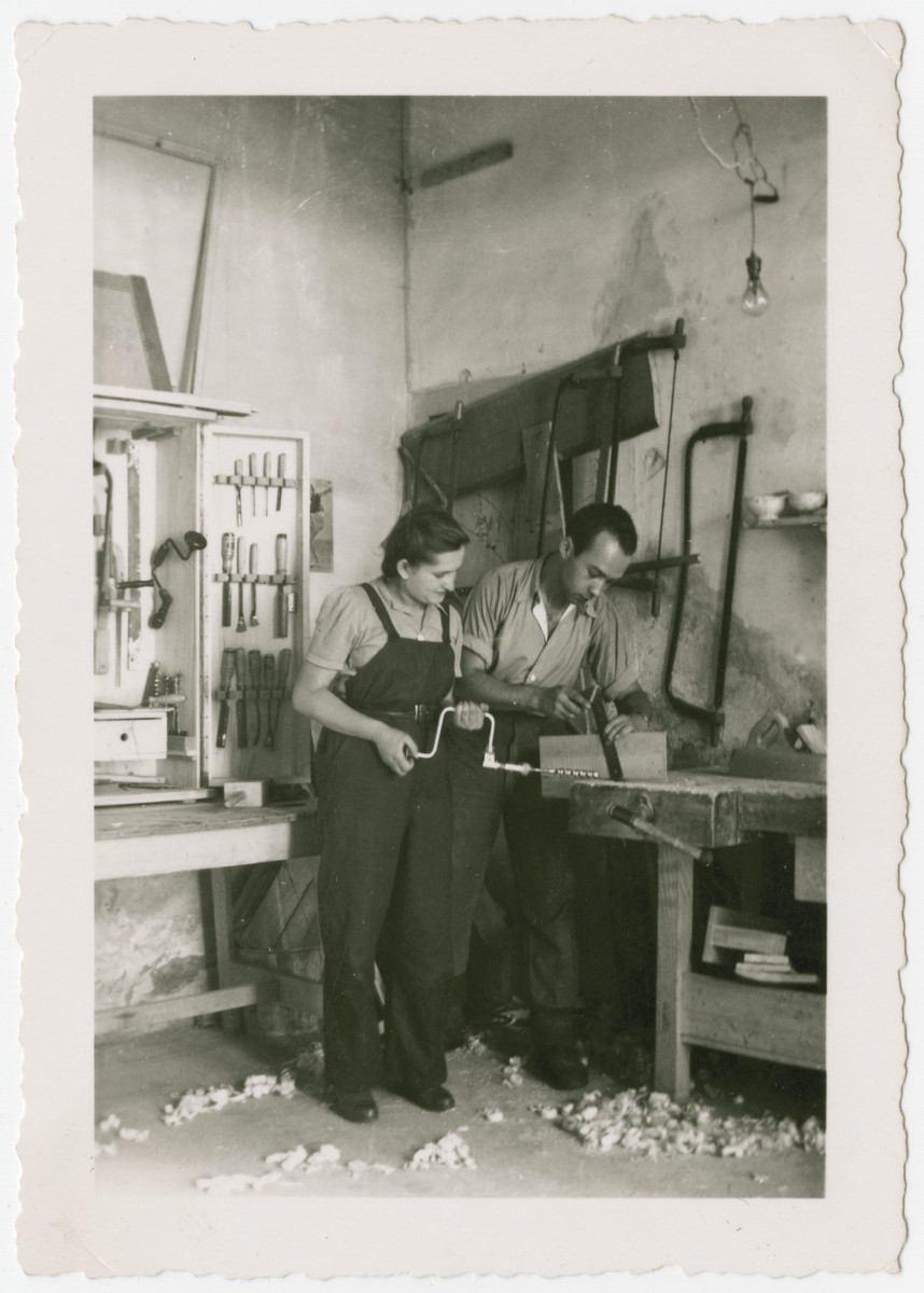Eva Weinberger works in the carpentry workshop [in what may be a kibbutz hachshara in Switzerland].