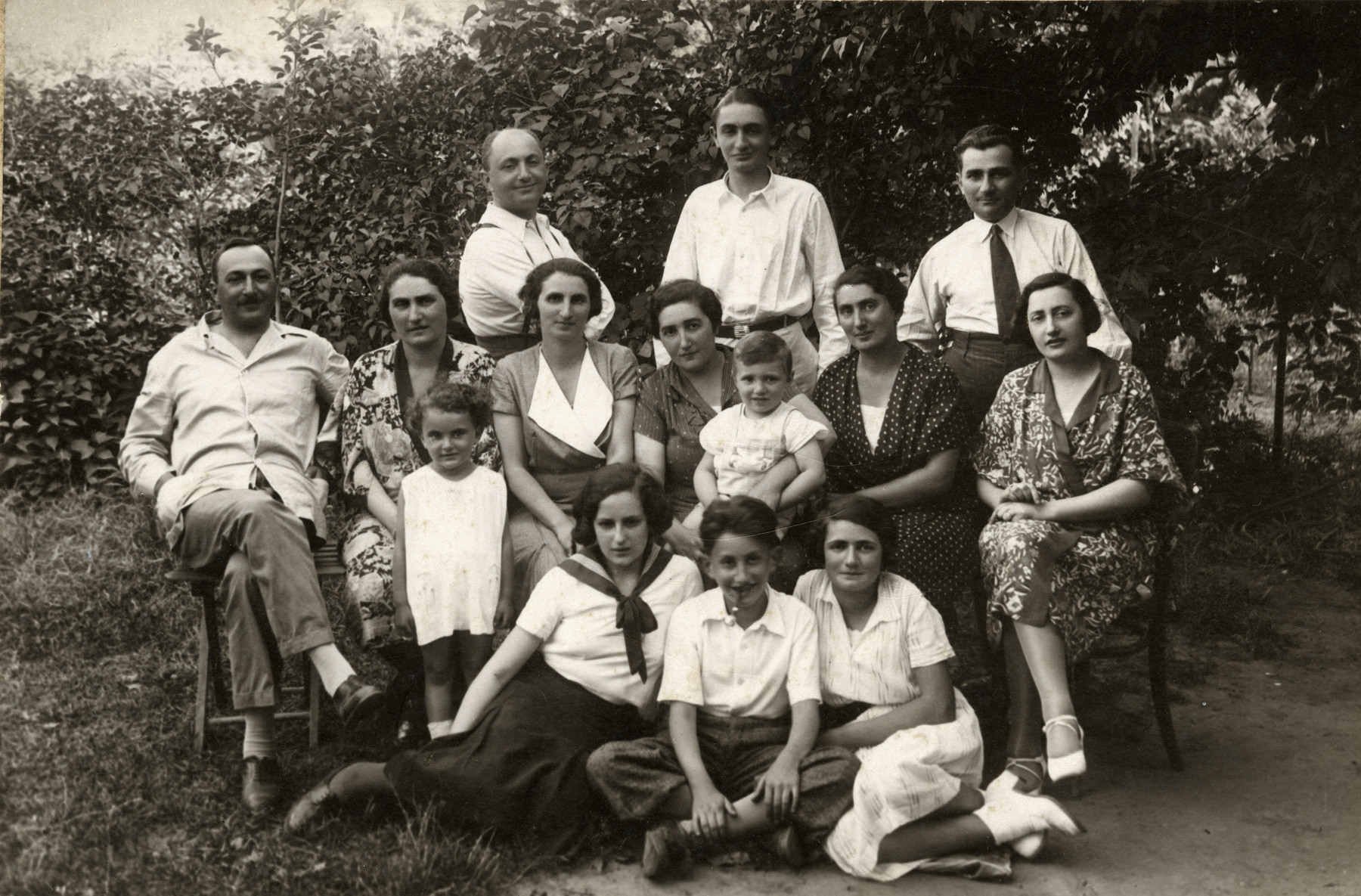 The Somlo family poses for a family portrait while on vacation near Lake Valencia.   Agnes is wearing a white dress.  Many of her cousins seen in this portrait were later killed in the Danube River on December 31, 1944.
