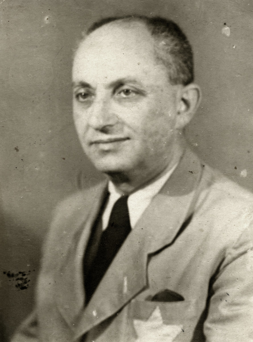 Studio portrait of Karl Somlo wearing the Jewish star in Budapest.