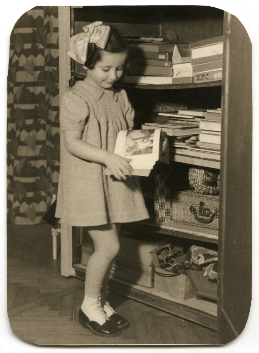 Agnes Steiner looks at a picture book in her home in Budapest.