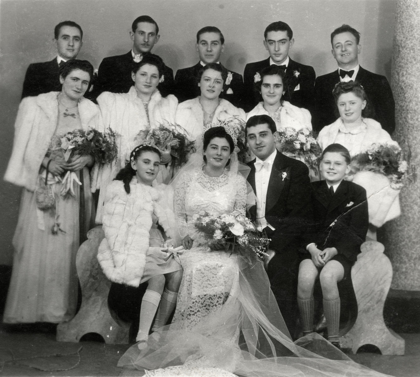 Wedding portrait of Zoltan Shiklos, cousin of the donor.  Zoltan Shiklos perished in the Holocaust. Agnes Somlo is pictured in the fur coat.