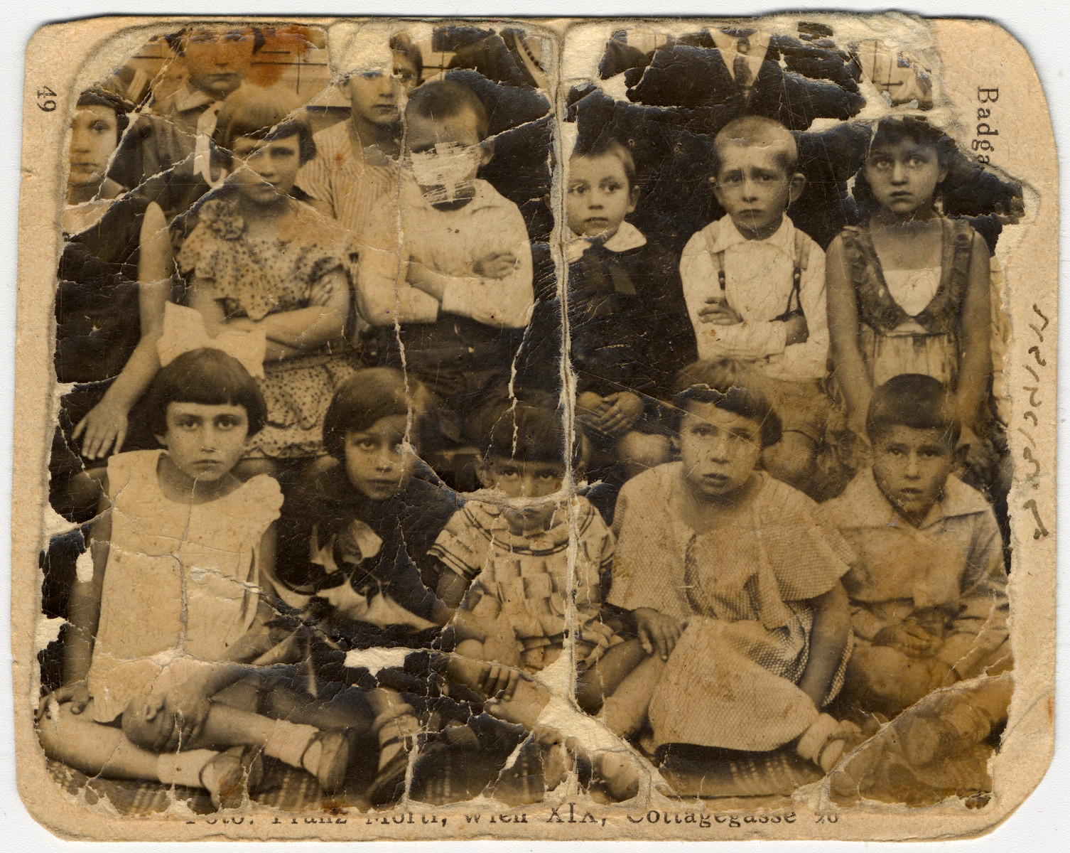 Group portrait of young children in a Jewish school in Nowogrodek.  Esther Ass is pictured in the front row, second from the left.