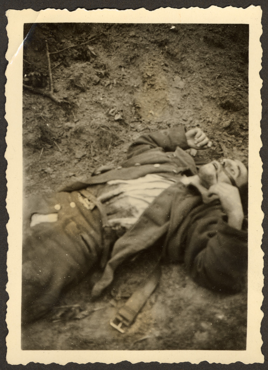 """A fallen Polish soldier, killed during the invasion of Poland.  Original German caption read: """"Picture of the edge of the street, Poland goes along with us completely."""""""