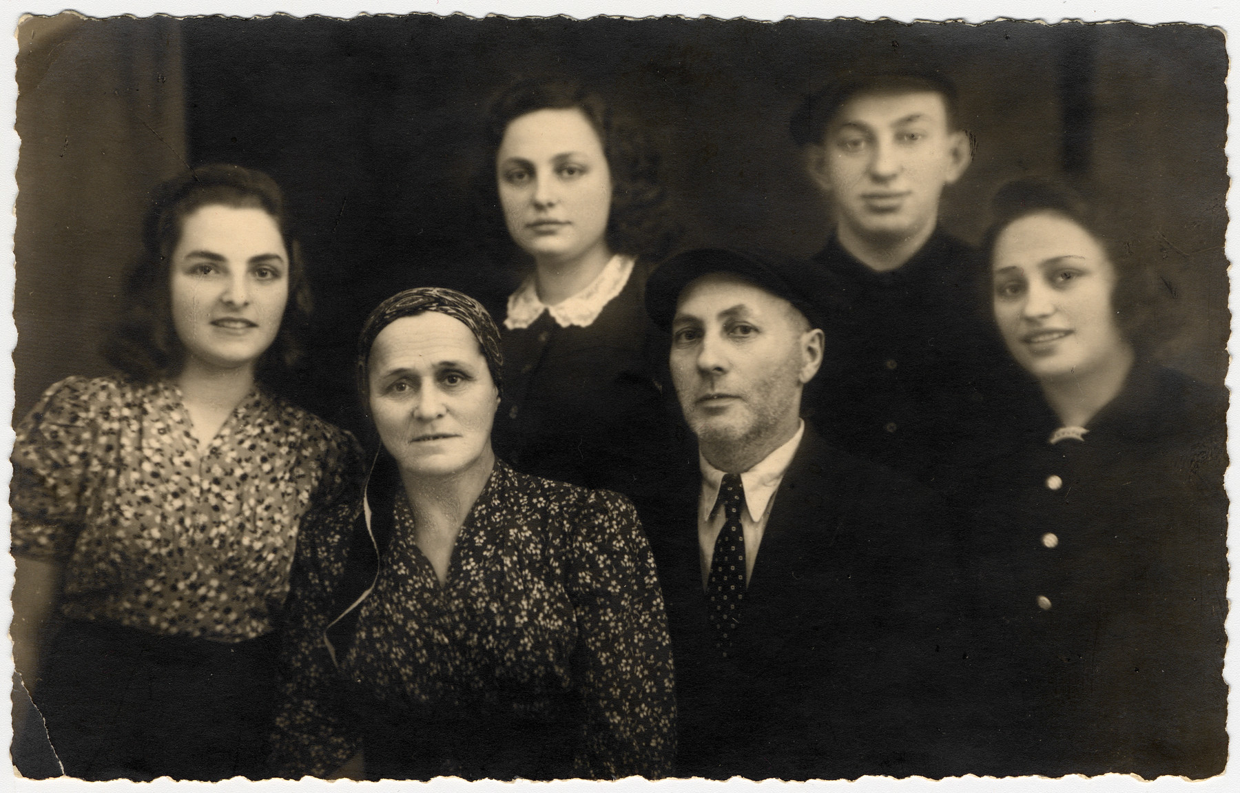 Postwar portrait of the Ass family who survived the war with the Bielski partisans.  From left to right are Chana Chamanovitch (their adoptive daughter), Beila, Itka, Yaakov Menachem, Yosef and Esther Ass.