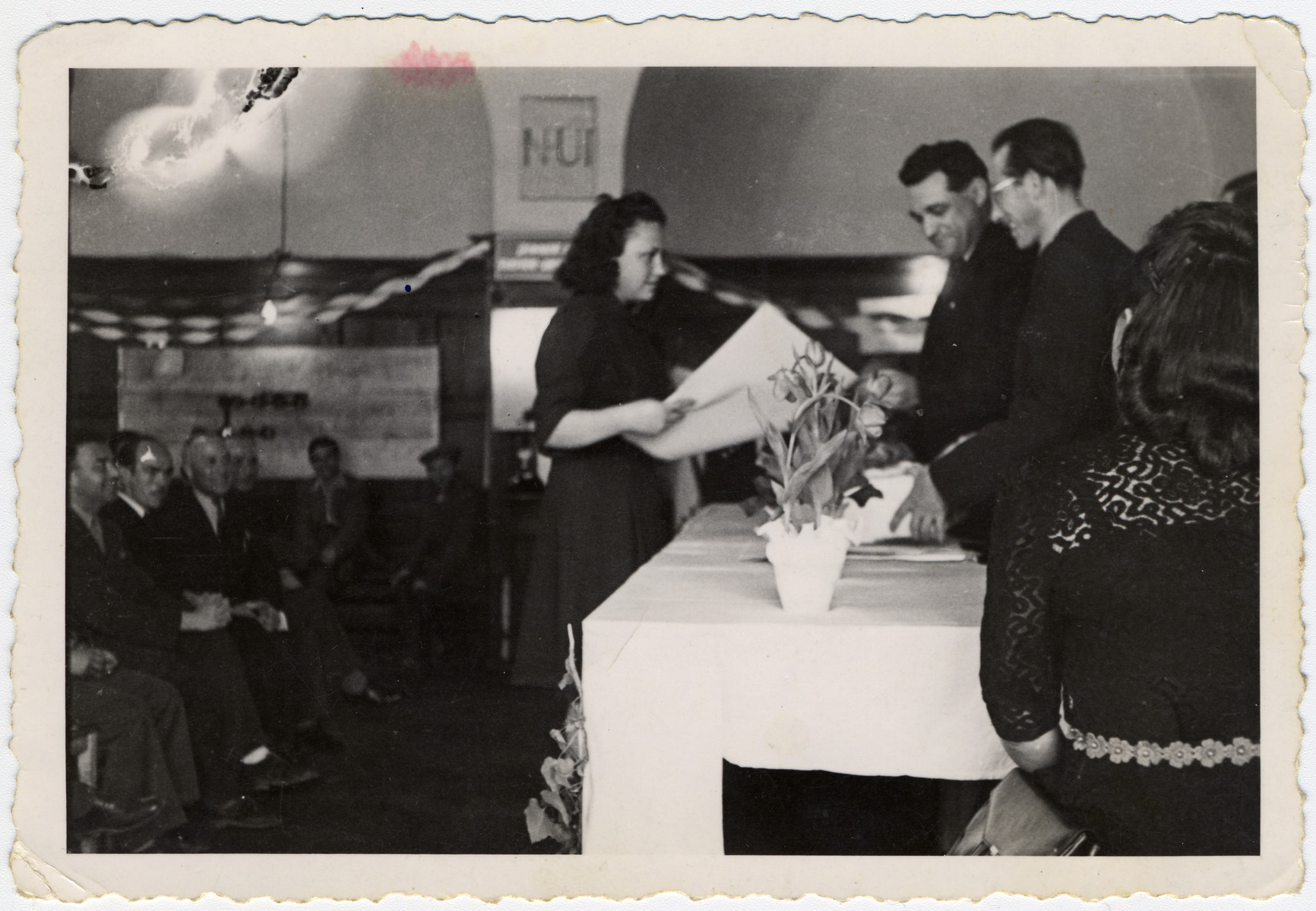 Esther Ass receives a certificate from the ORT school in the Beit Bialk displaced persons' camp.