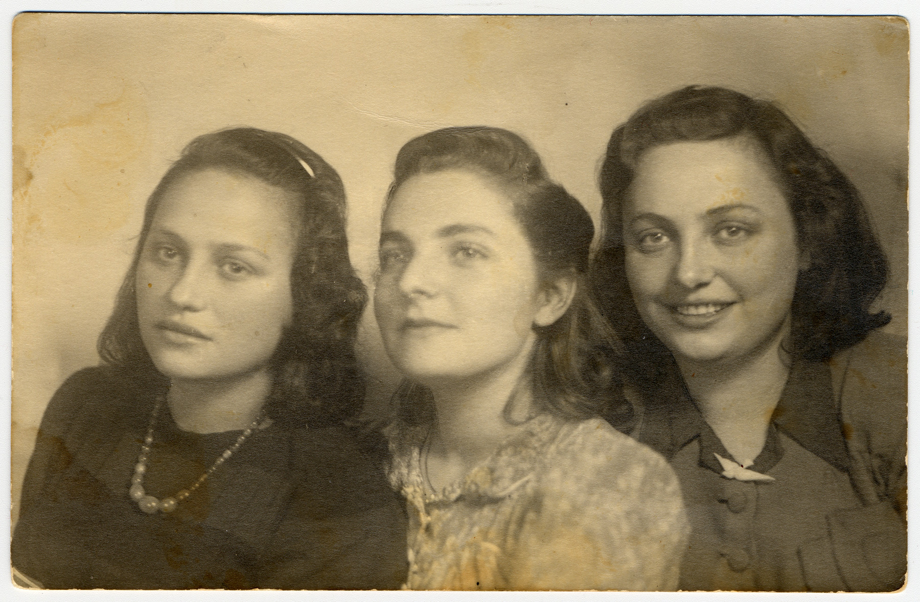 Postwar portrait of three Jewish sisters.  Pictured from left to right are Esther Ass, Chana Chamanovitch (an orphan who was unofficially adopted by the Ass family after the war) and Itke Ass.