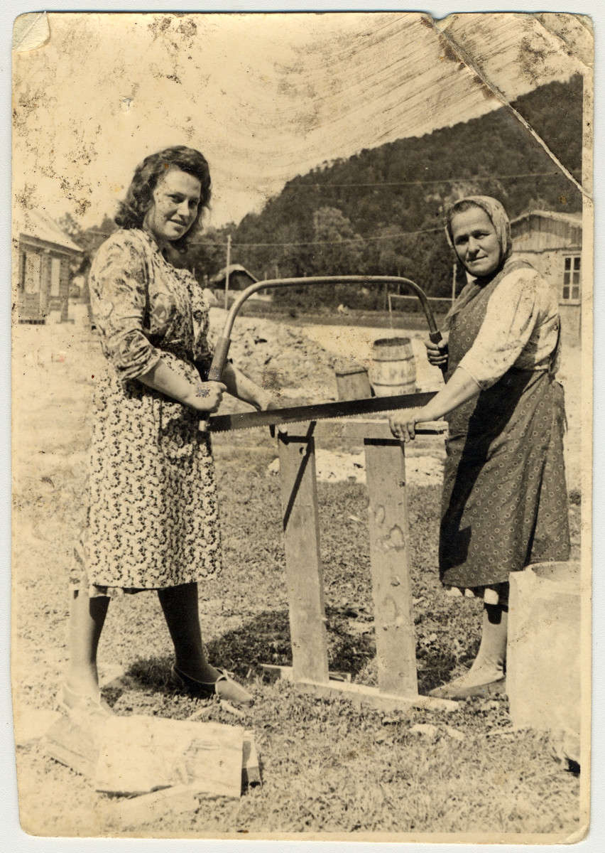 Esther and her mother Baile Ass saw wood in [what is probably] the Bad Gastein displaced persons' camp.