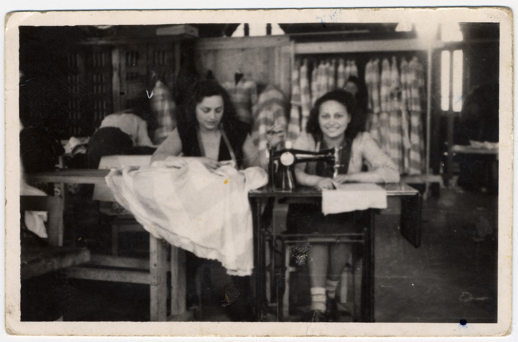 Two girls work at sewing machines at an ORT school in the Beit Bialik displaced persons' camp in Salzburg, Austria.  Pictured are Esther Ass and Chana Chamanovitch.
